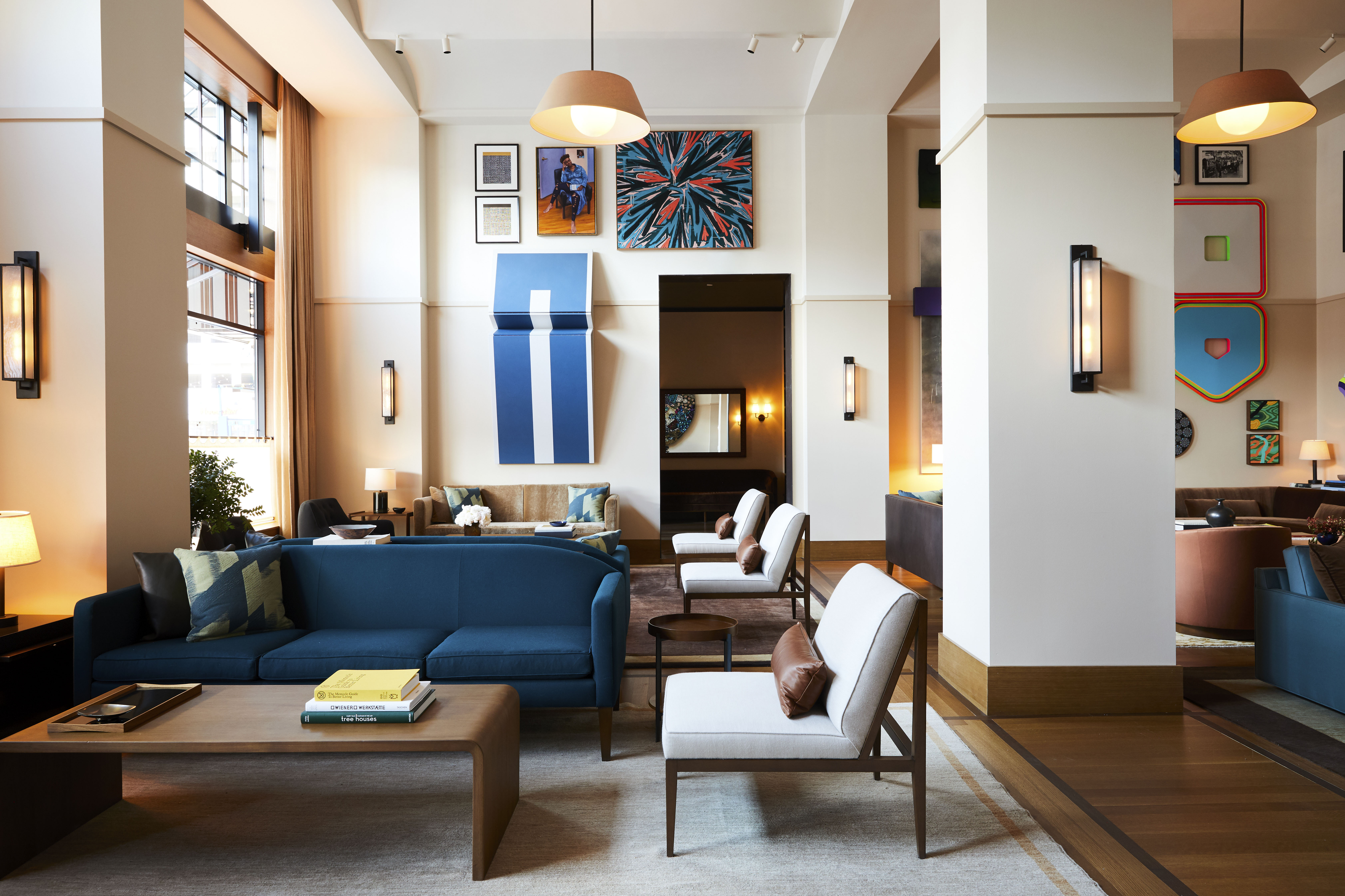 The living room at the Shinola Hotel is a common area for hotel guests and has a hip vibe with its plush couches and bright artworks | Shinola Hotel| Gachot Studio | STIR