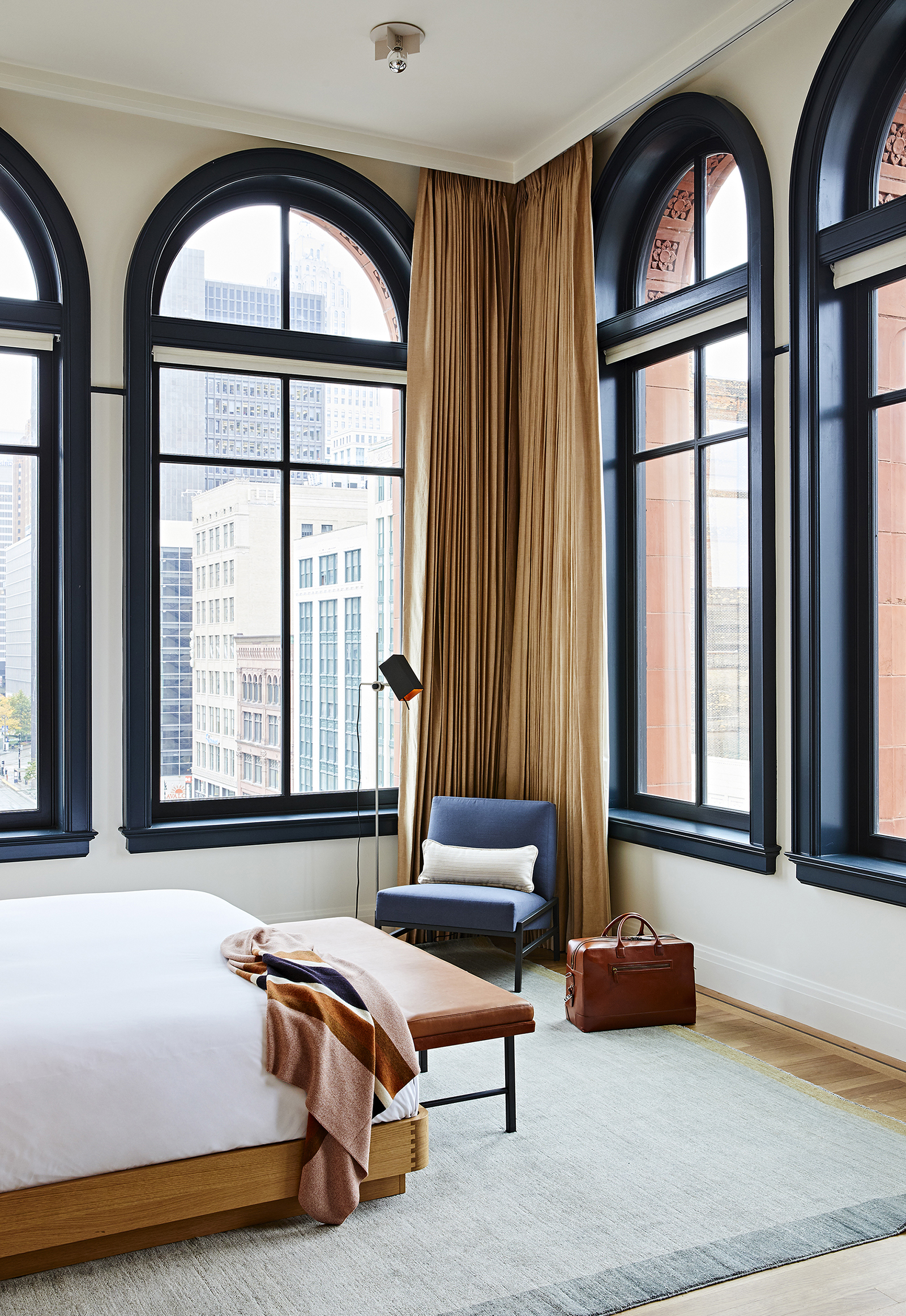 The structure retains its neoclassical features like the arch seen here in one of the rooms | Shinola Hotel| Gachot Studio | STIR
