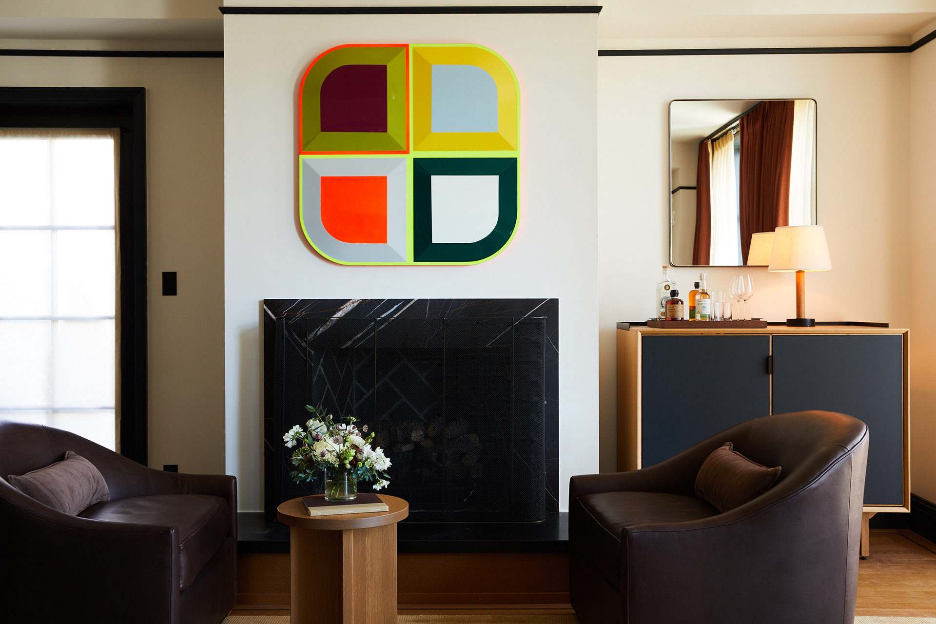 Mid-century modern furniture, bright artworks, and plush furniture is peppered throughout the rooms | Shinola Hotel| Gachot Studio | STIR