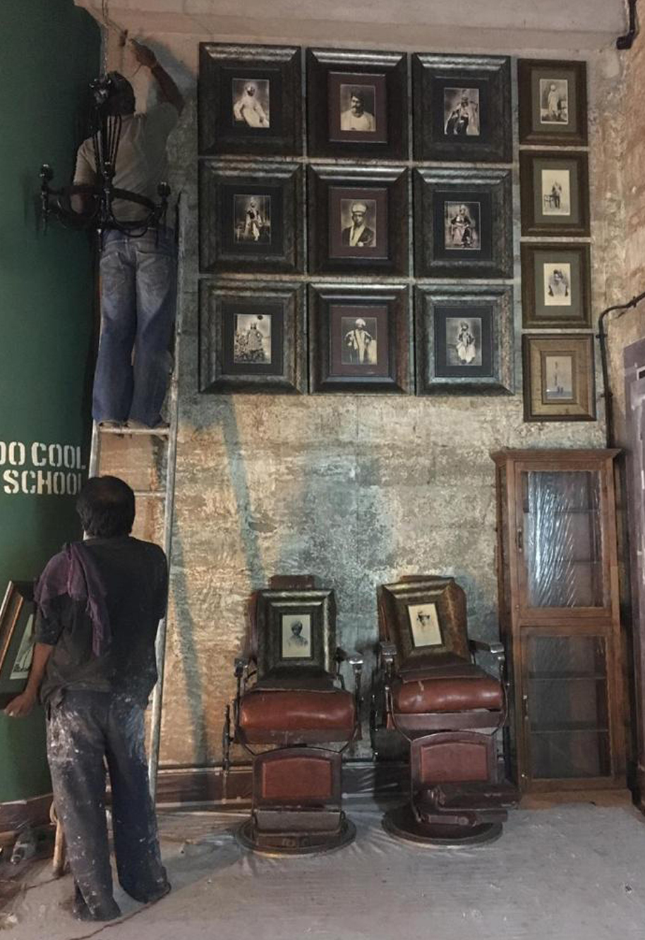 Vintage photographs being put up on the wall of Arjun Khanna's studio| Arjun Khanna| STIR