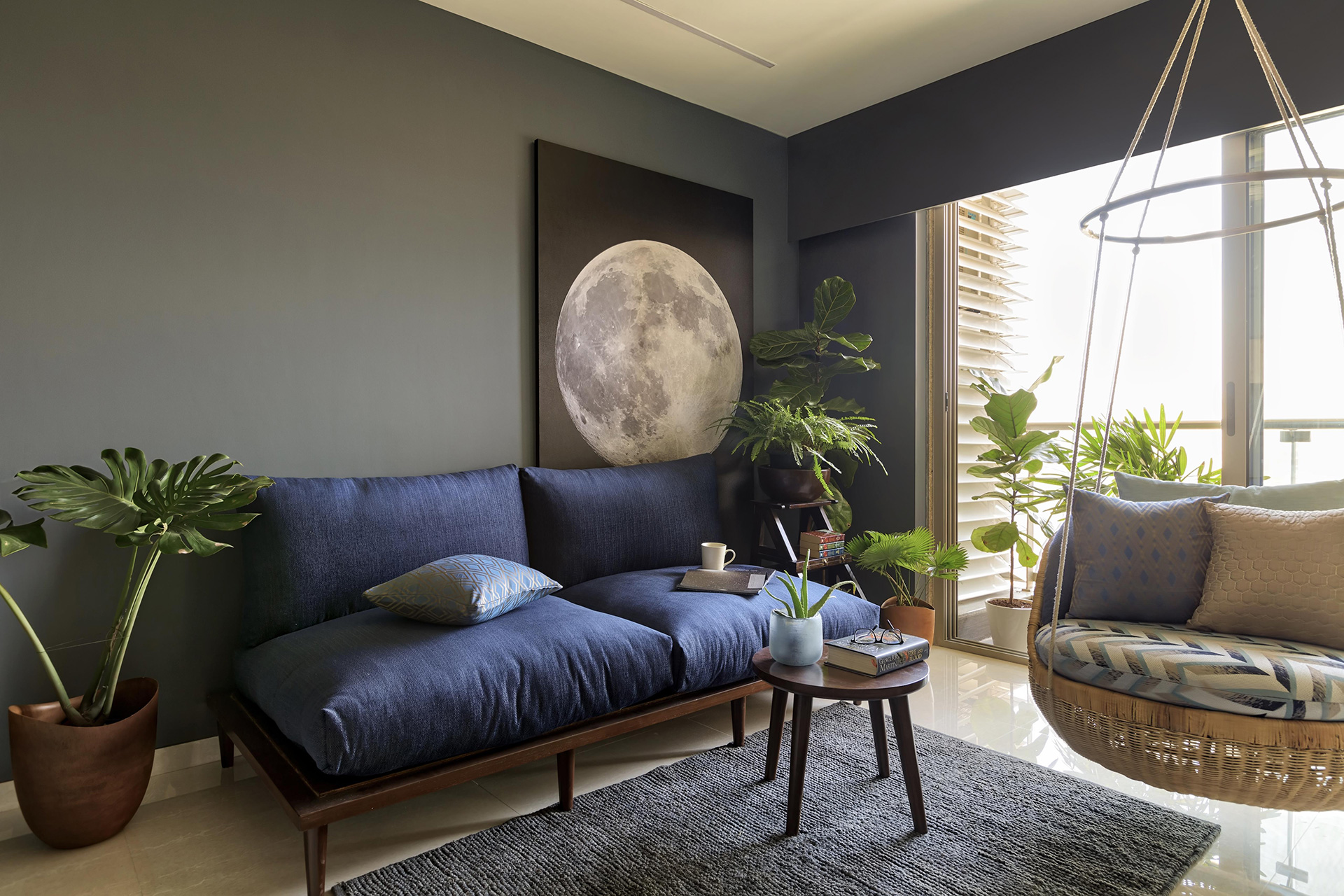 The moon canvas serves as the backdrop to the living area and is the first thing you see as you enter this city 3-BHK flat | Anu Chauhan, Prashant Chauhan| Zero9| STIR