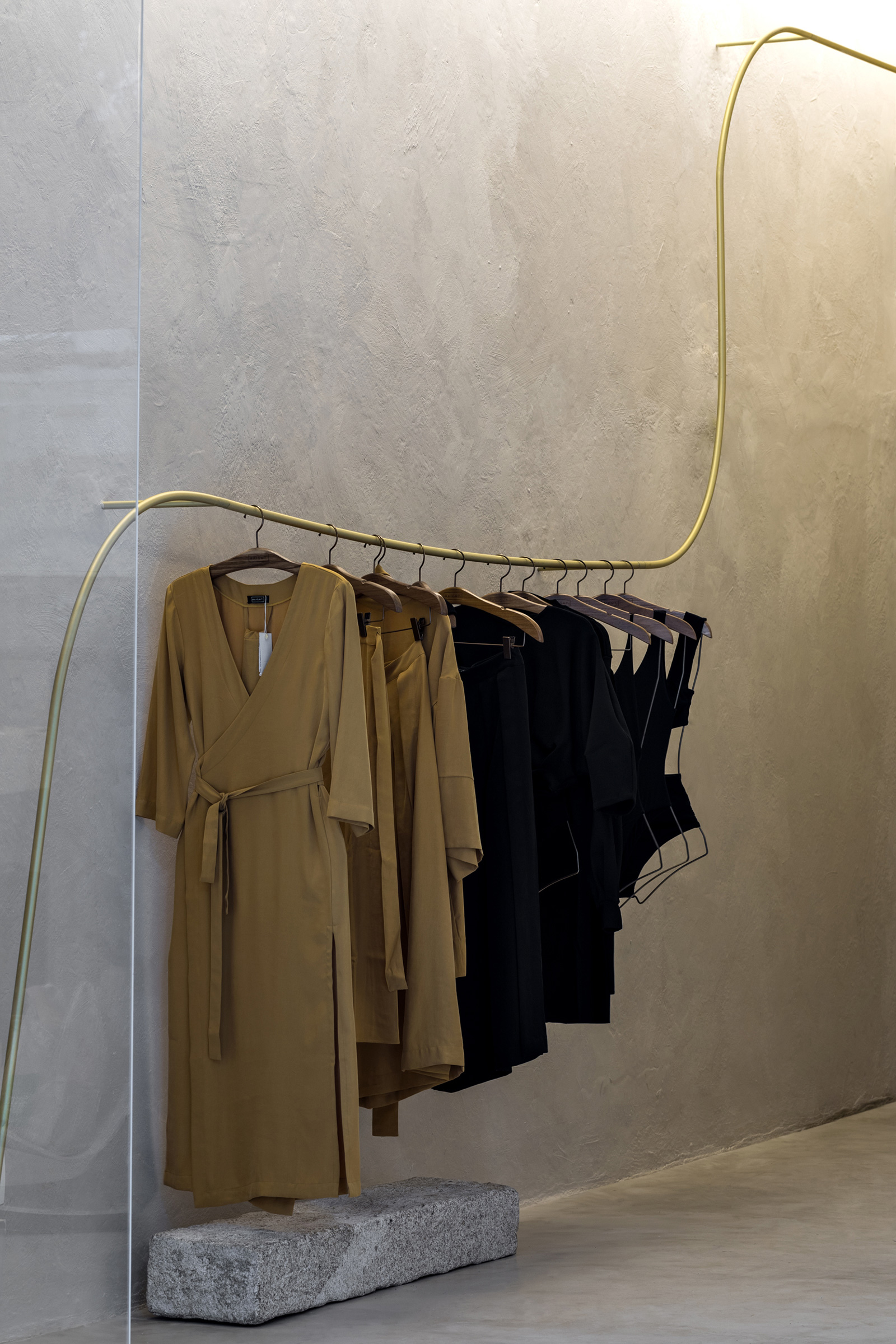Fluid metal wires run offset the walls to hang the brand's latest clothing | HAIGHT Store | MNMA studio | STIR