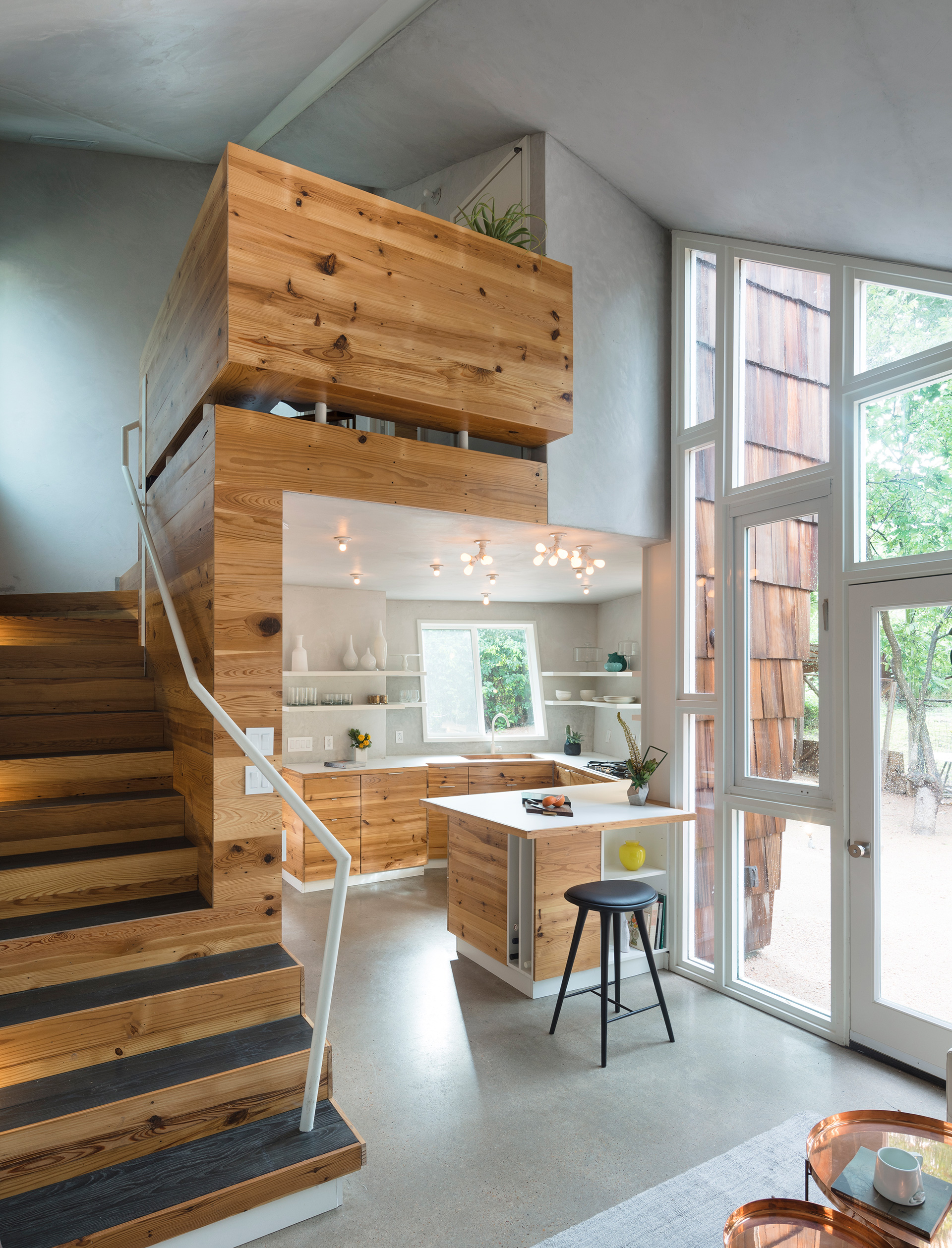 A view of the kitchen and the single flight of stairs, from the living area | The Hive| Nicole Blair | Studio 512 | STIR