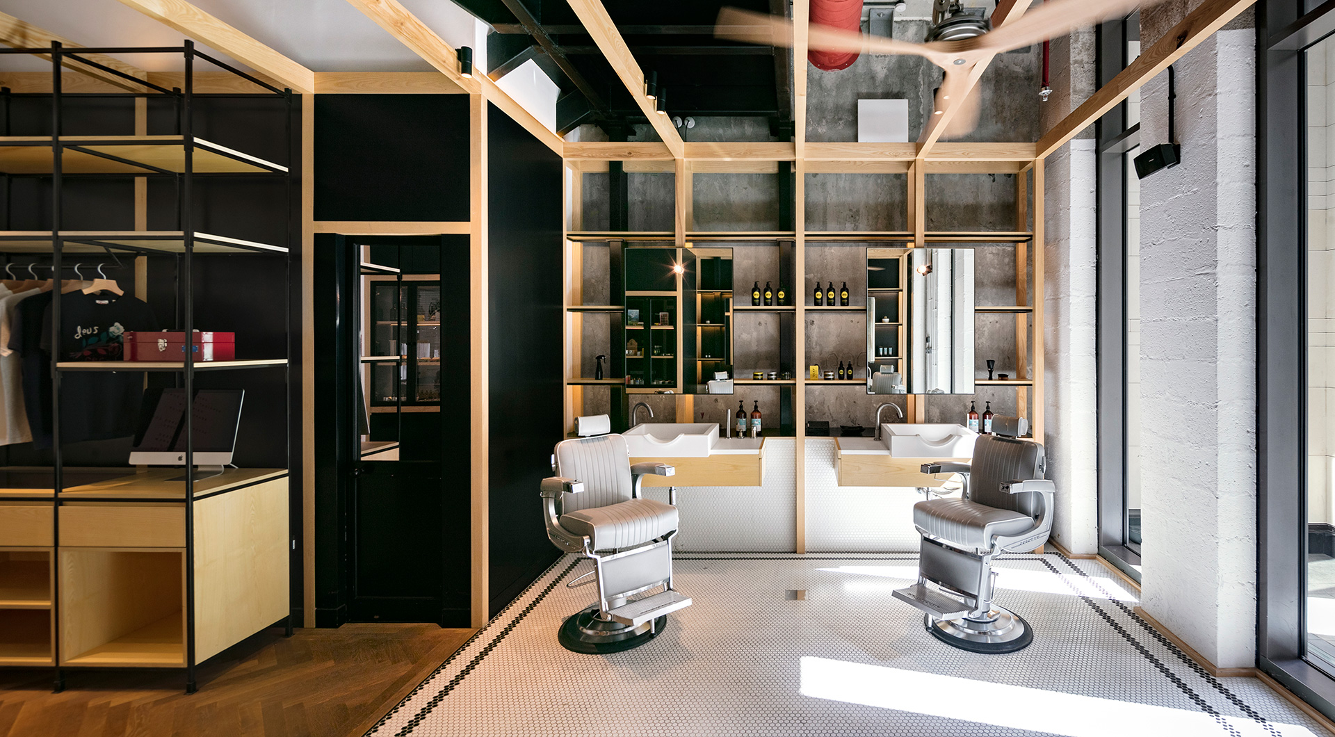 The timber module against the dark background provides modish, compartmentalised areas within the barbershop | Akin at The Beach| Akin Barber and Shop| Anarchitect| STIR