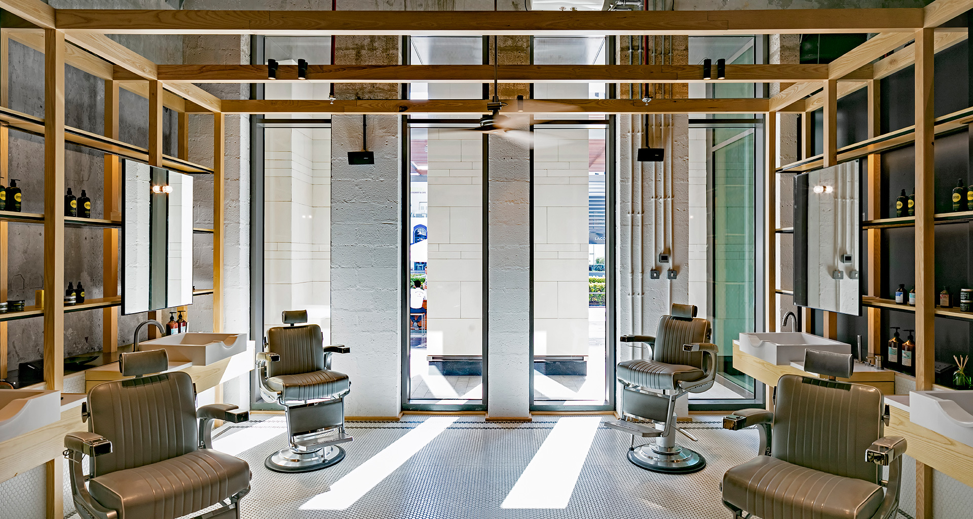 Full height slot windows at the salon let in sunlight| Akin at The Beach| Akin Barber and Shop| Anarchitect| STIR