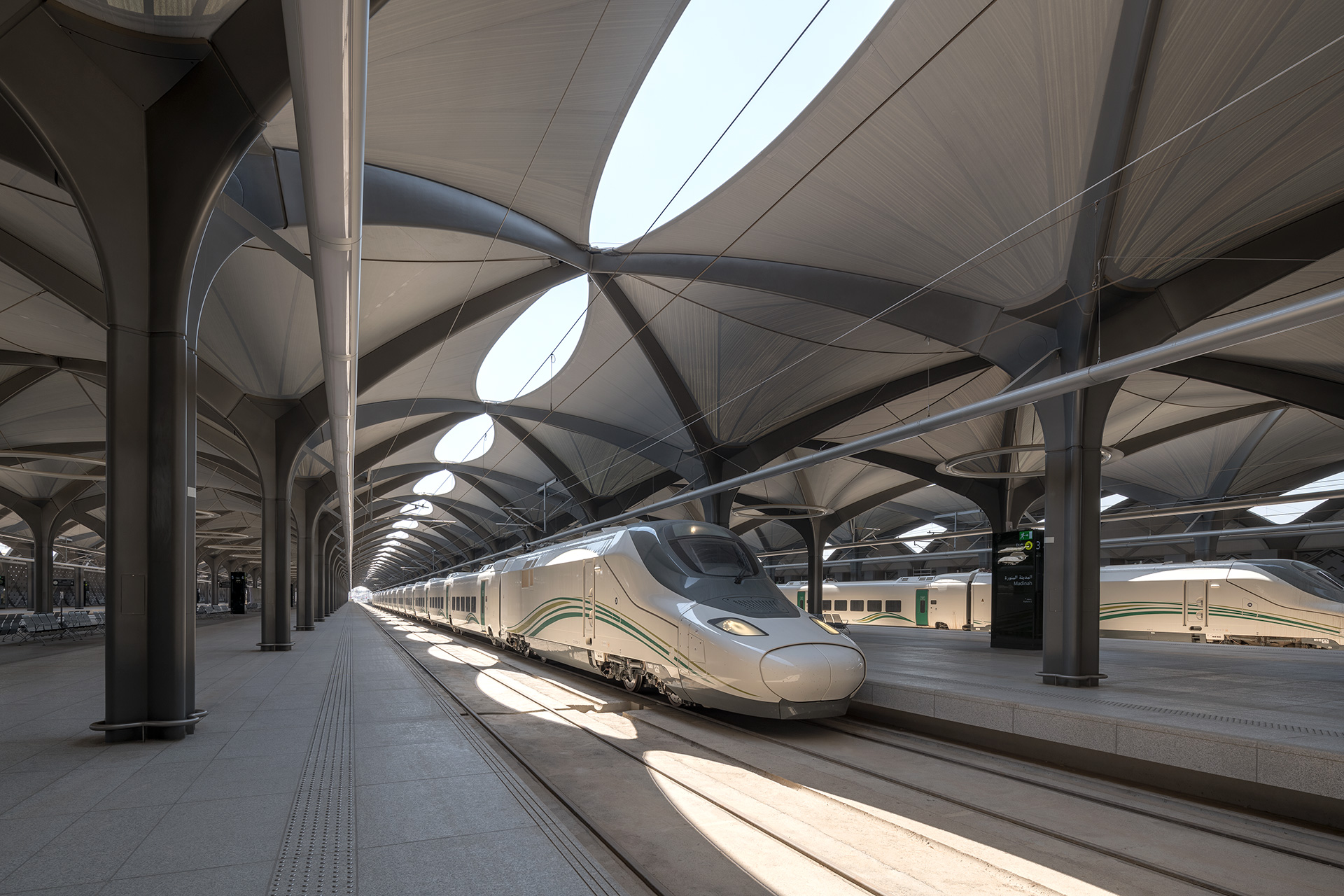Madinah Metro has steel columns and arches forming freestanding structural trees that are repeated on a square grid, connecting to form a flexible vaulted roof, inspired by the colonnades found in many traditional buildings in the region | Haramain High Speed Rail | Foster + Partners| STIR