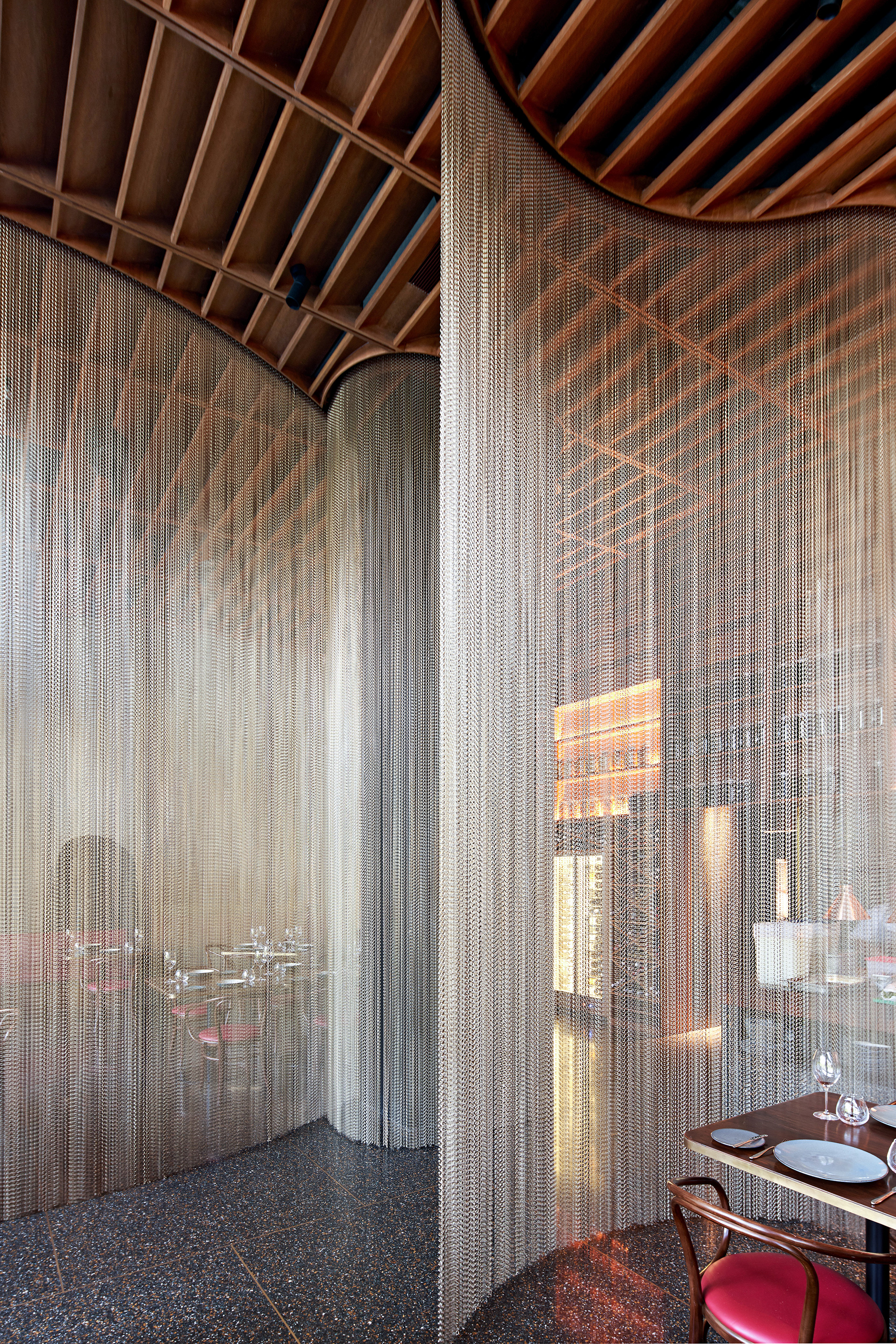 A semi-transparent bronze curtain provides a soft, almost sensual backdrop to the seating, its sweep defining each bay, while unifying them all visually as a singular continuum| Qualia| Rahul Akerkar| STIR