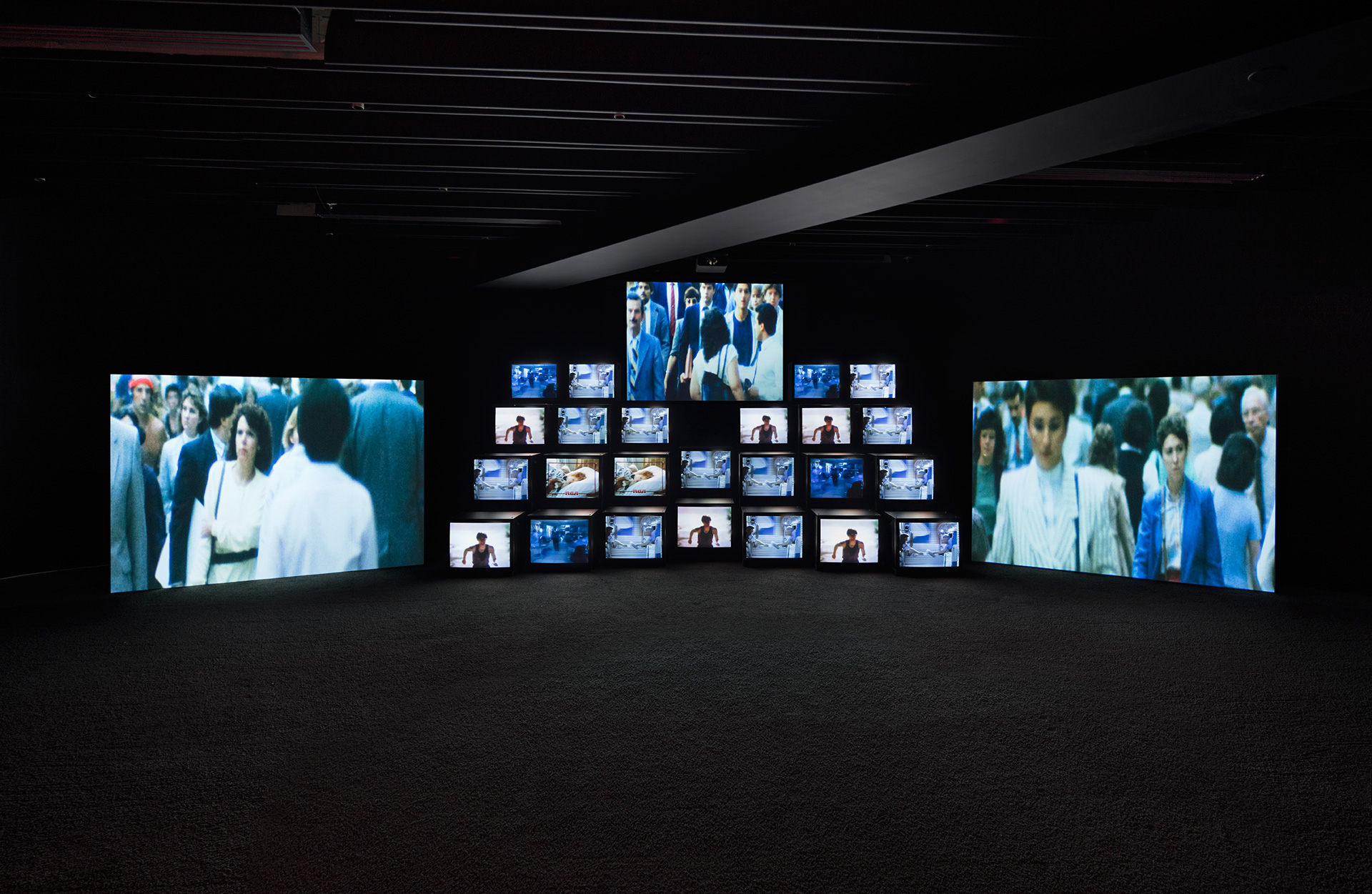 Total Recall, 1987. 11-channel video installation on 24 monitors and 3 projection screens, 18.2 min, with soundtrack by Stuart Argabright. Installation view of Gretchen Bender: So Much Deathless at Red Bull Arts New York, 2019 | Gretchen Bender | STIR