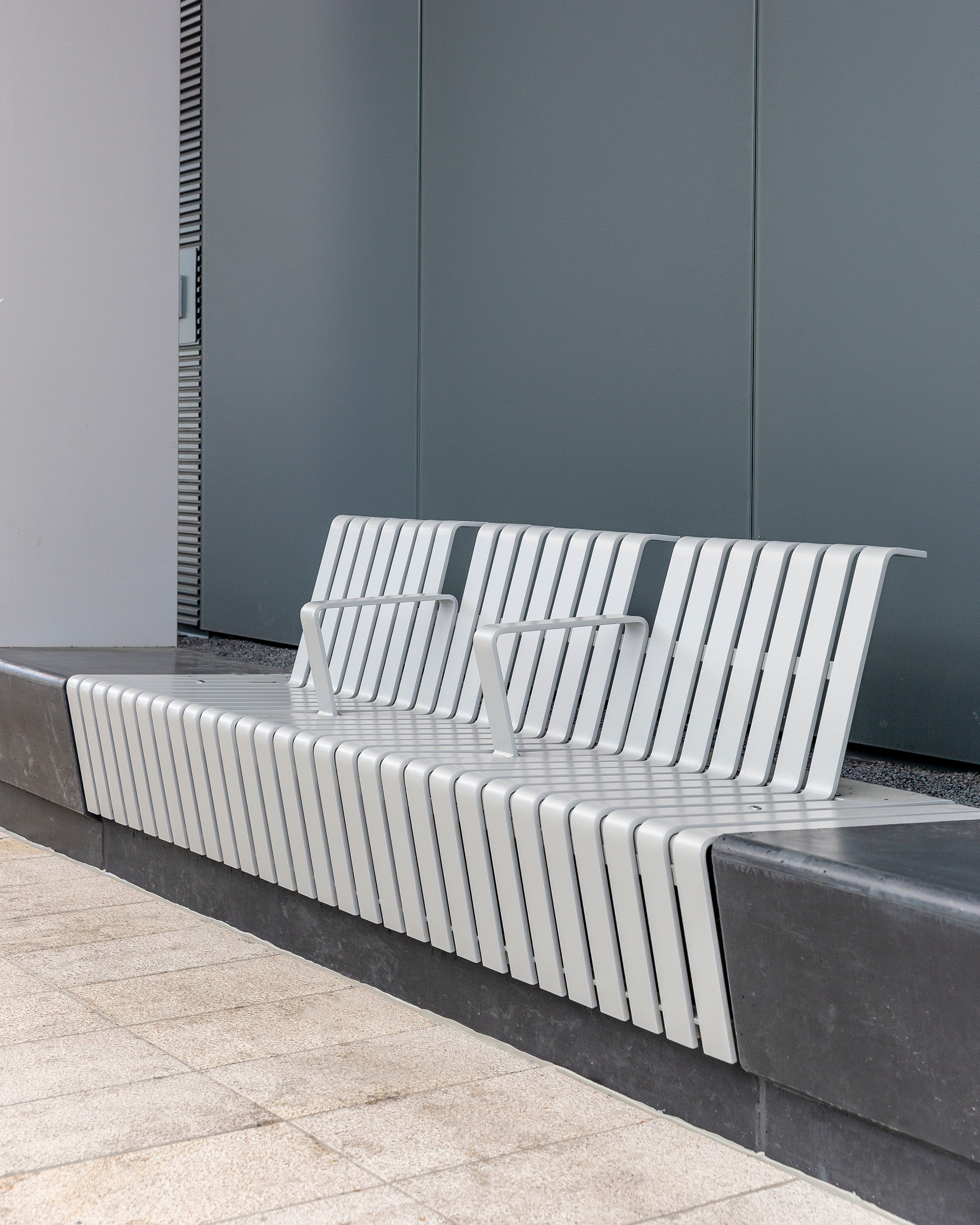 The seating at the bus station consists of black pigmented concrete containing a number of seats executed in strip steel with integrated heating | Tilburg Bus Station| Cepezed| STIR