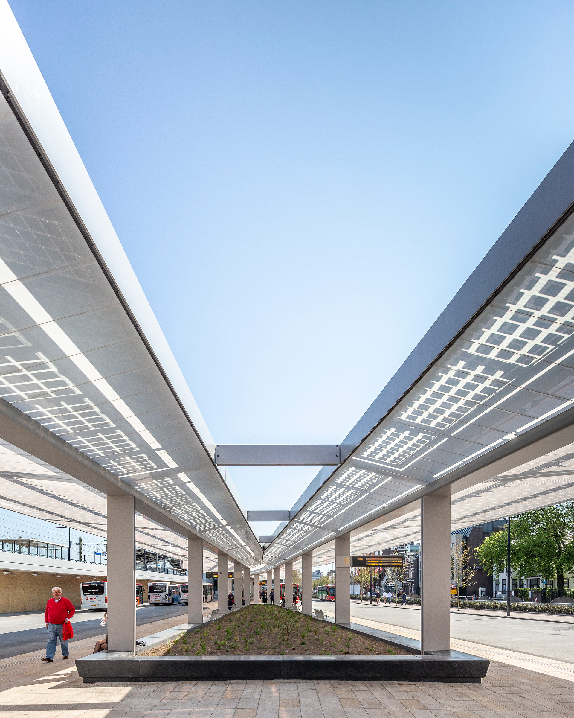 Movement sensors have been integrated into the steel edge of the awning of the Tilburg bus station every 14 metres, which respond to the presence of buses and people and thereby optimising energy usage | Tilburg Bus Station| Cepezed| STIR