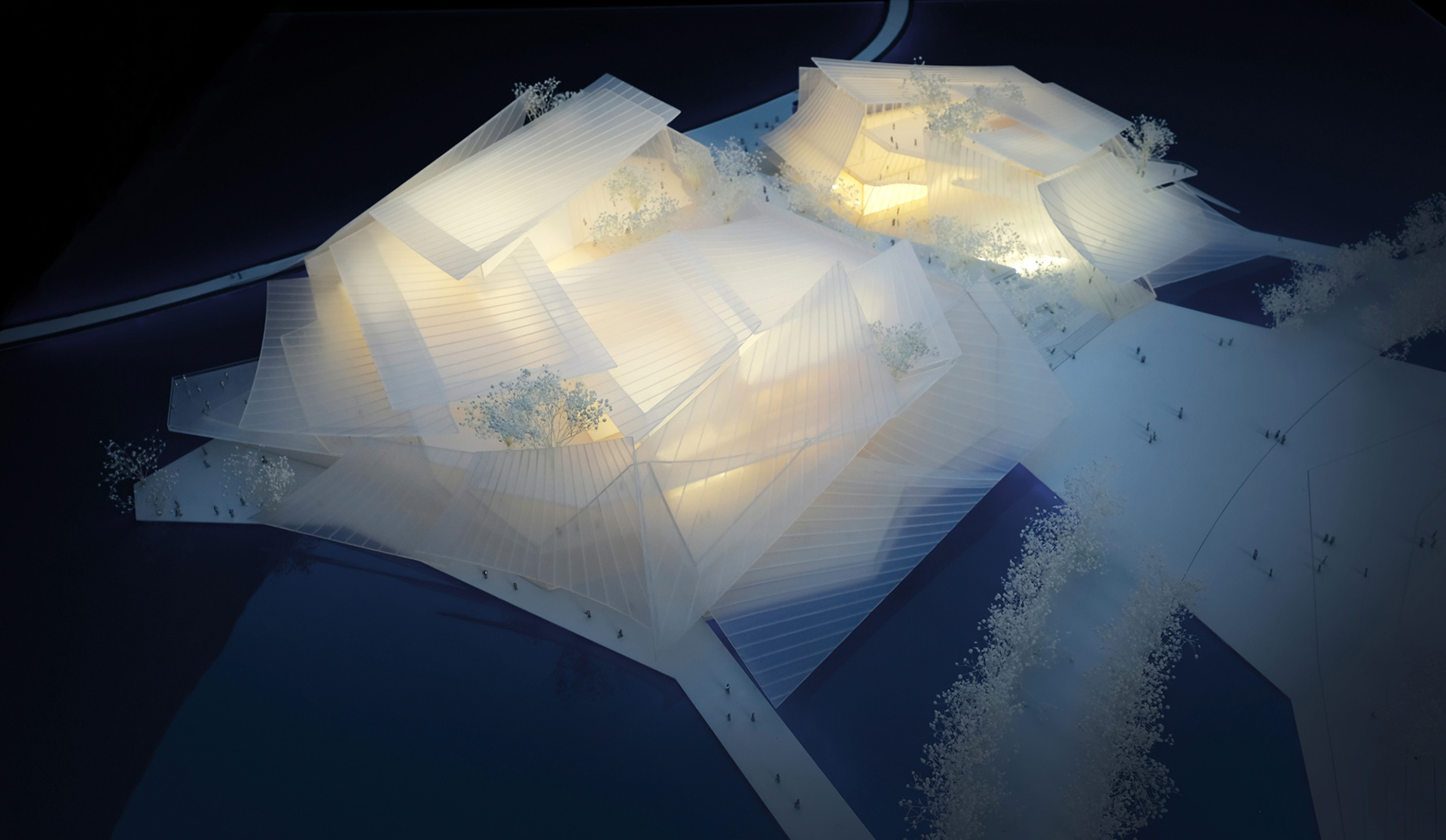 The structure is covered with a canopy of light fabric-like glass sails | Yiwu Grand Theater | MAD Architects | STIR