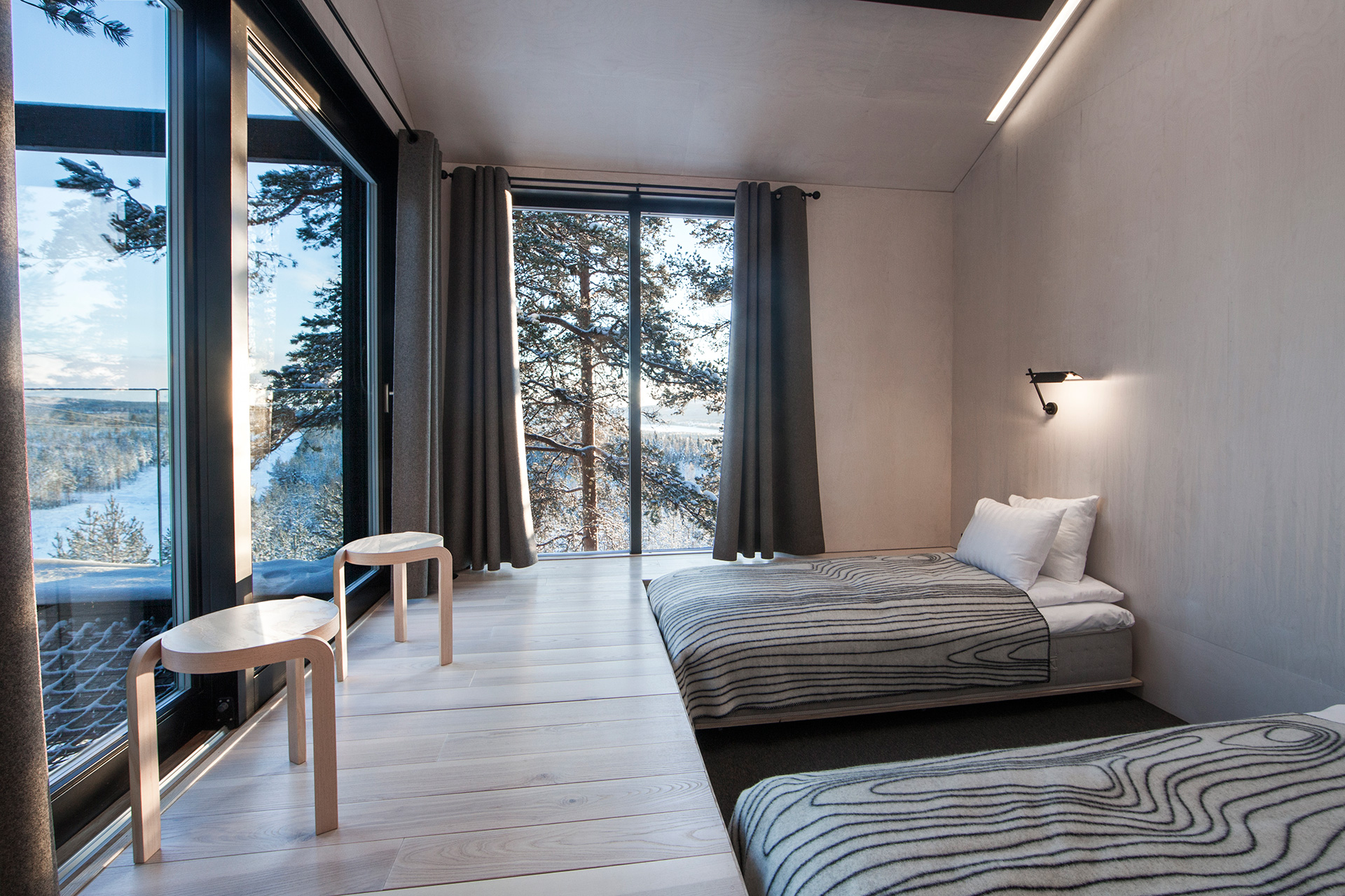 In the 7th Room, large panoramic windows face north and along with skylights in the bedrooms offer a view of the magnificent northern lights | Treehotel | Kent, Britta Lindvall | STIR