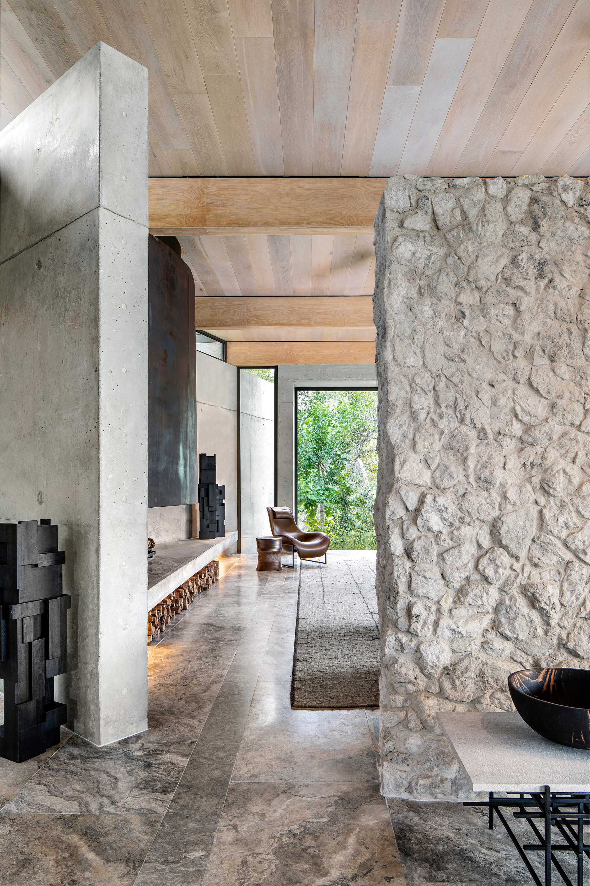 Raw stone and concrete walls against timber ceiling create a creative contrast of softness and warmth | Cheetah Plains | ARRCC | STIR