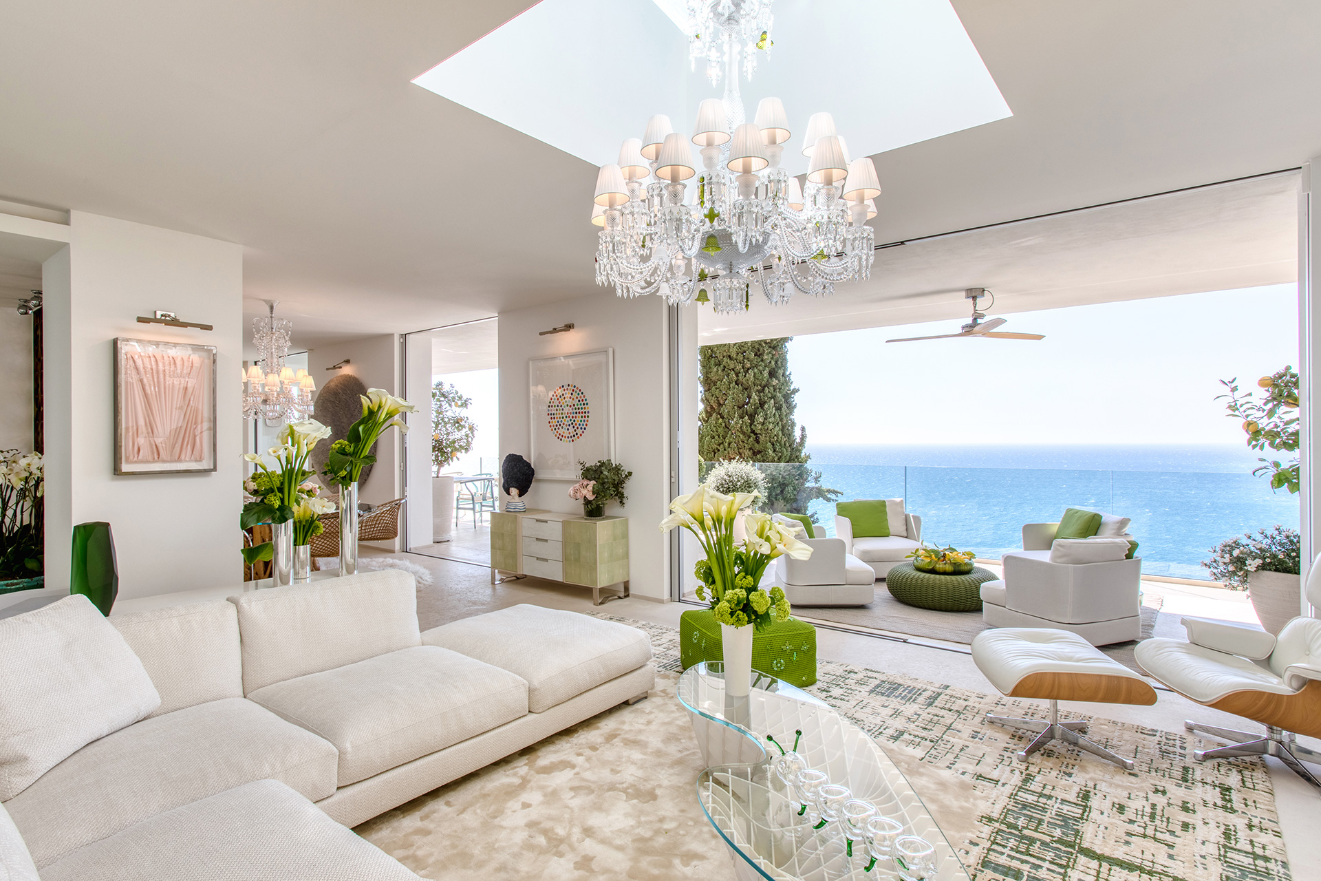 Picture windows, framing the stunning blue water beyond, are an important style element in this home | Villa Riviera | Sabrina Monteleone-Oeino | STIR