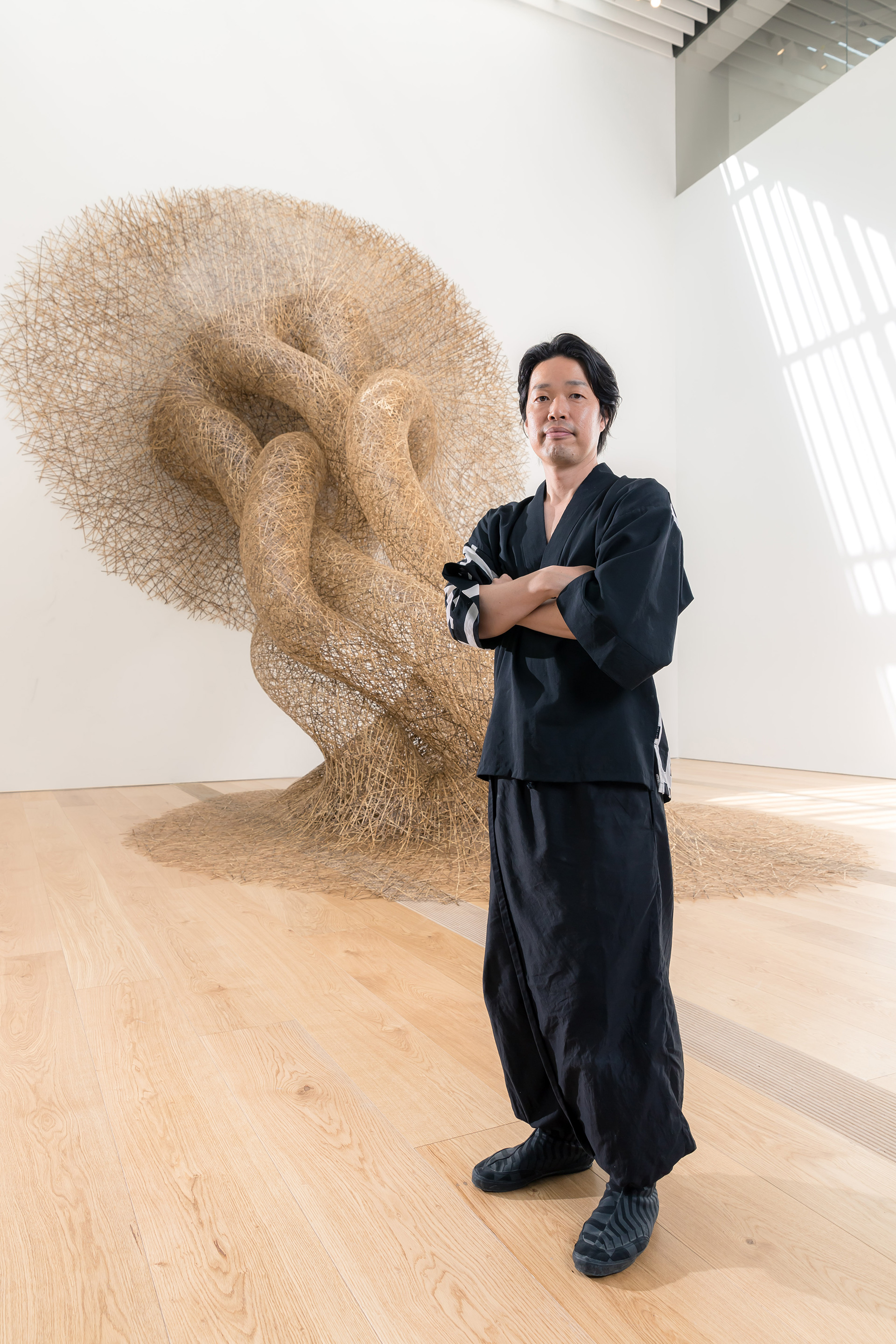 Tanabe Chikuunsai IV photographed with his bamboo installation, exhibited at OMM | Odunpazari Modern Museum| Kengo Kuma and Associates | STIR