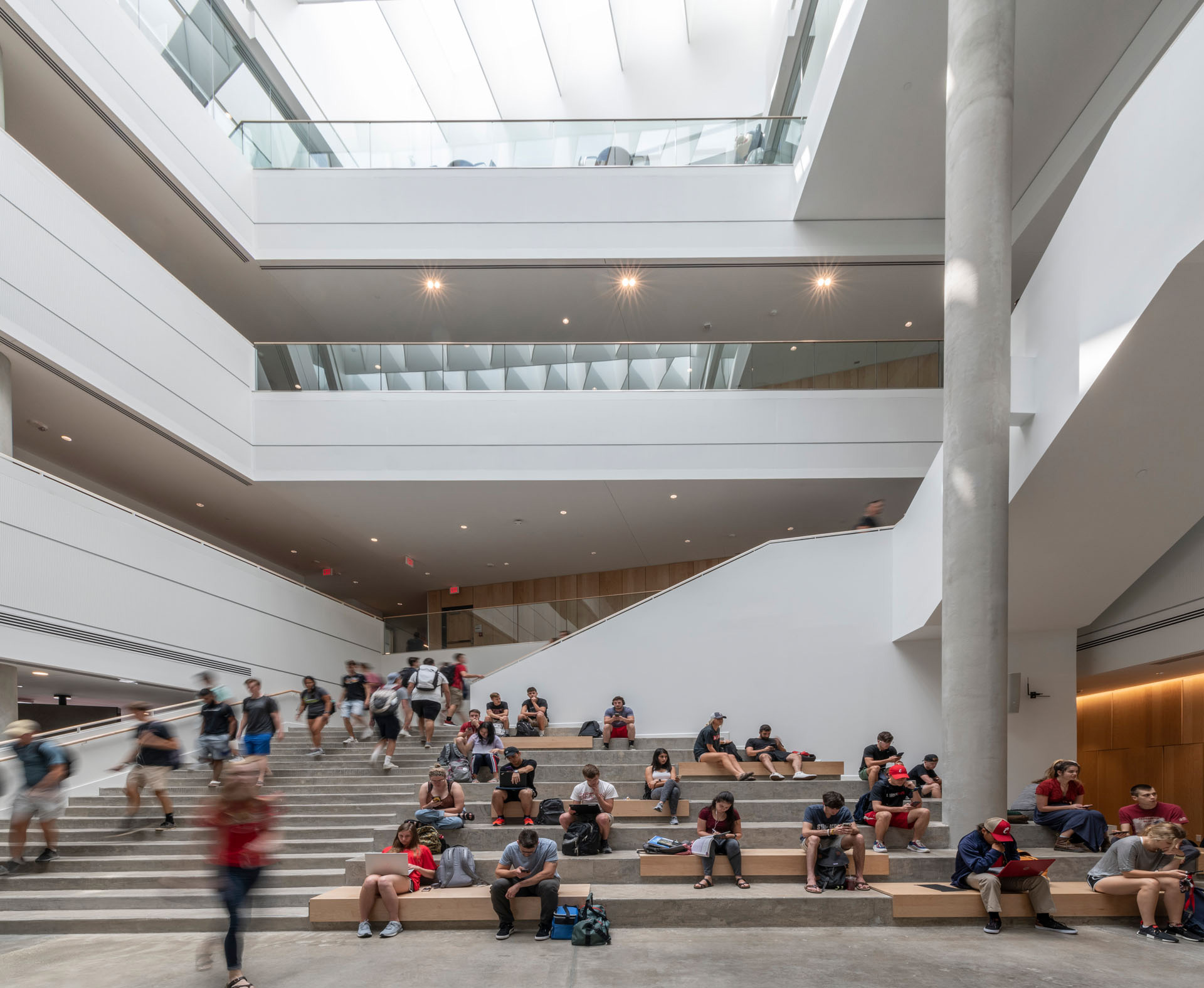 The steps in the atrium connects to the various floors and also act as an informal seating platform  | University of Cincinnati's Lindner College of Business | Henning Larsen | STIRworld