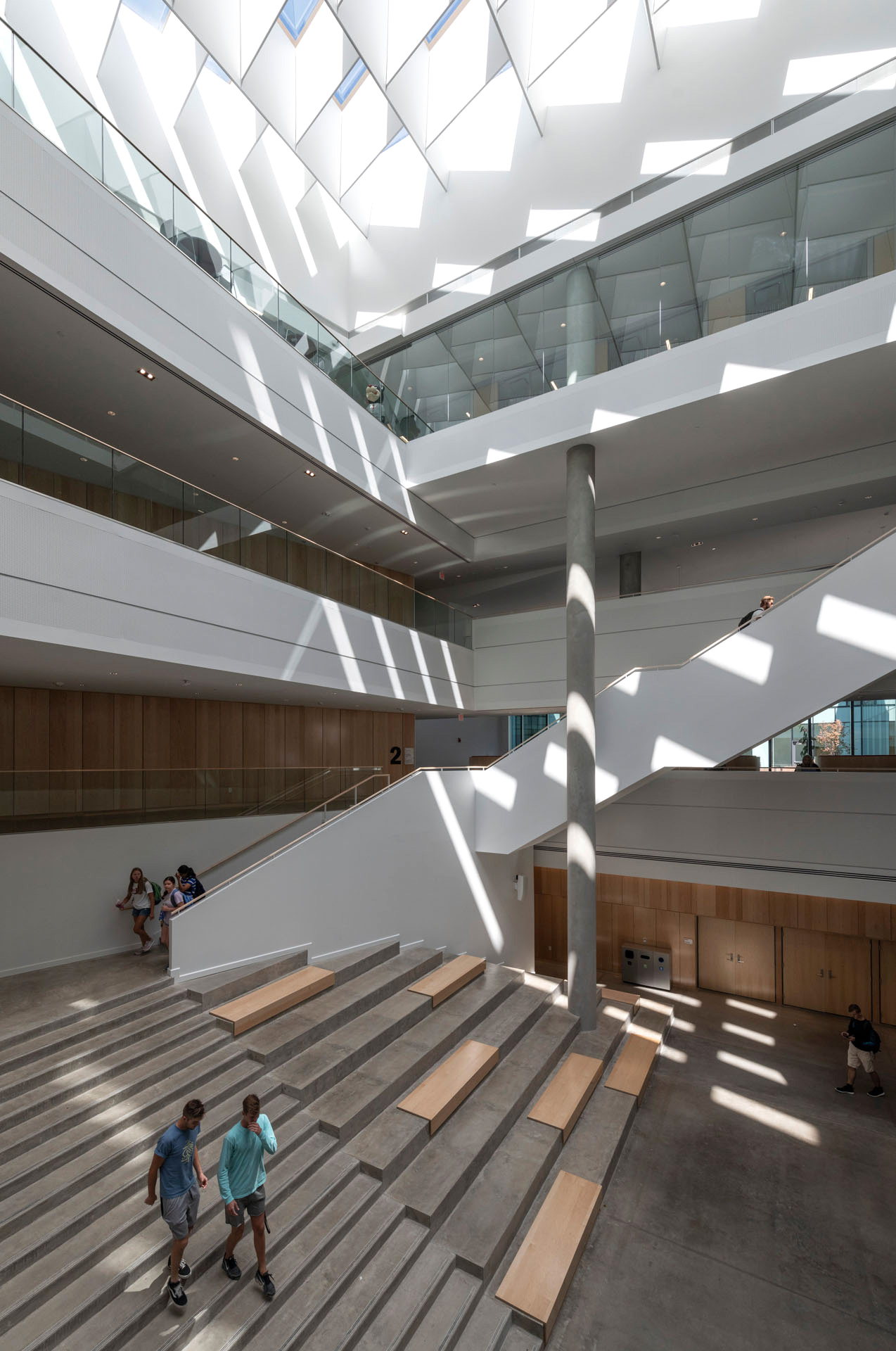Geometric shadows casting on the atrium walls create an immersive environment | University of Cincinnati's Lindner College of Business | Henning Larsen | STIRworld