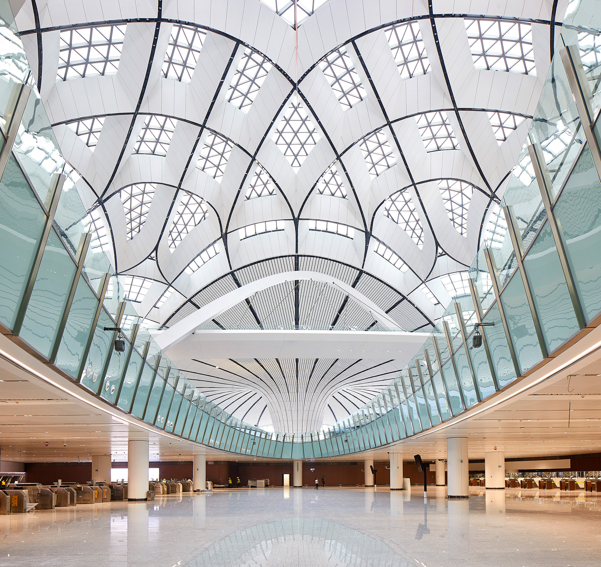 Natural daylight entering the terminal through a network of linear skylights | Beijing Daxing International Airport | Zaha Hadid Architects | STIRworld