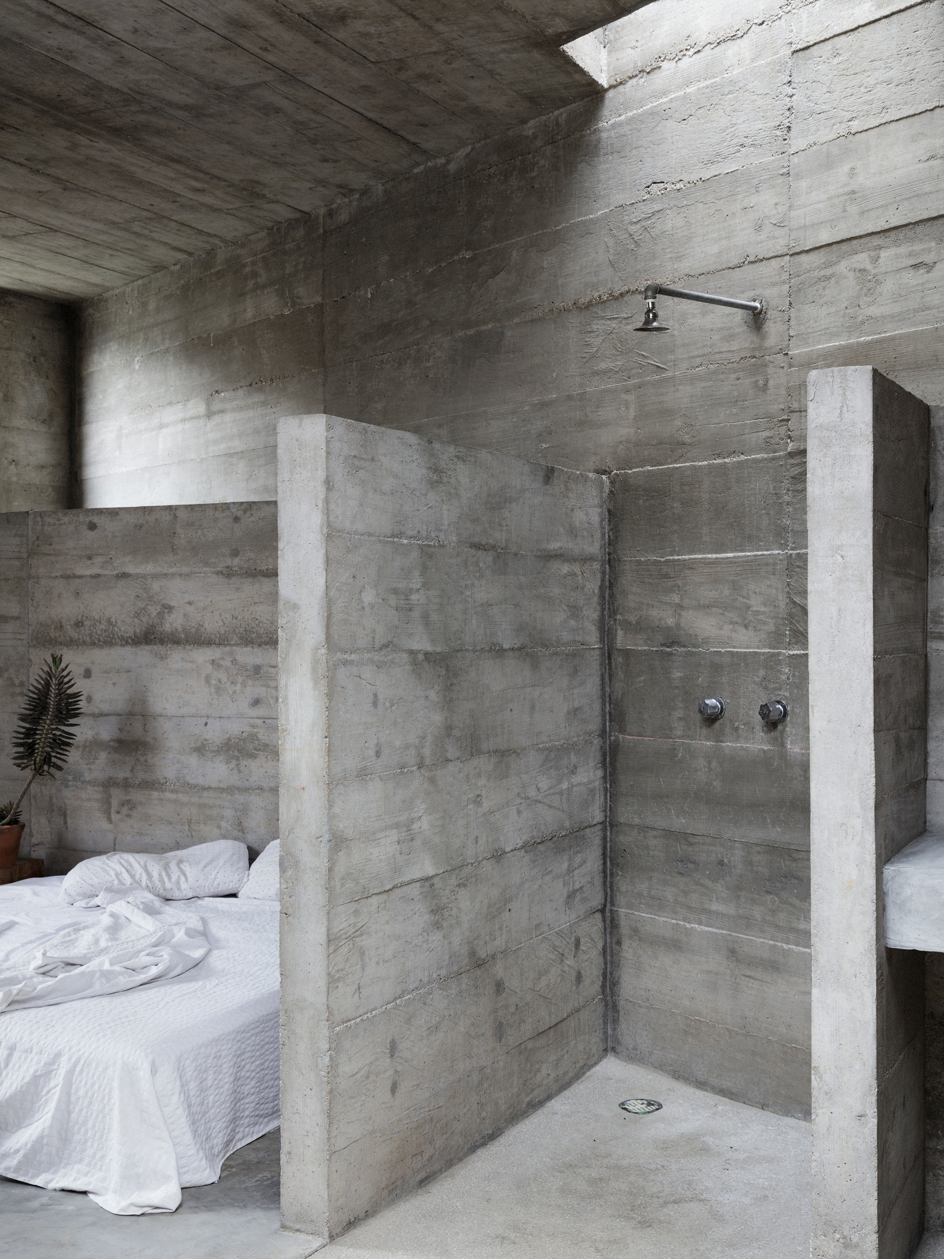 The glass-less bedrooms with concrete floors have minimal furnishings | Zicatela House | Mexico | Ludwig Godefroy |STIRworld