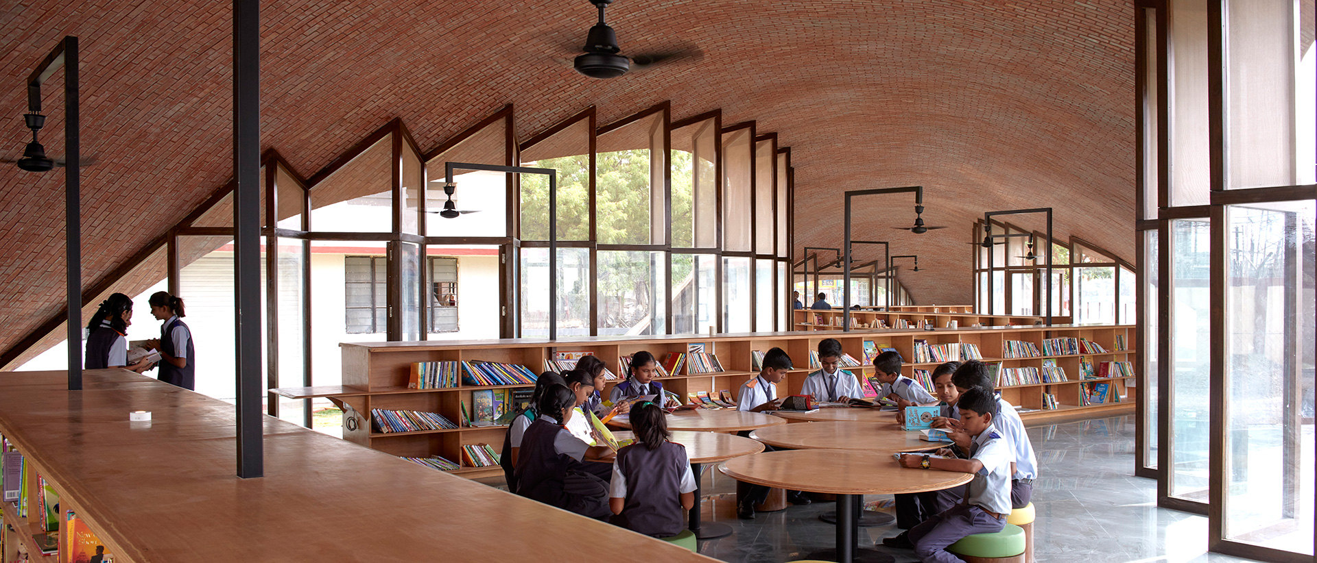 Students reading inside the structure | Maya Somaiya Library | sP+a | STIRworld