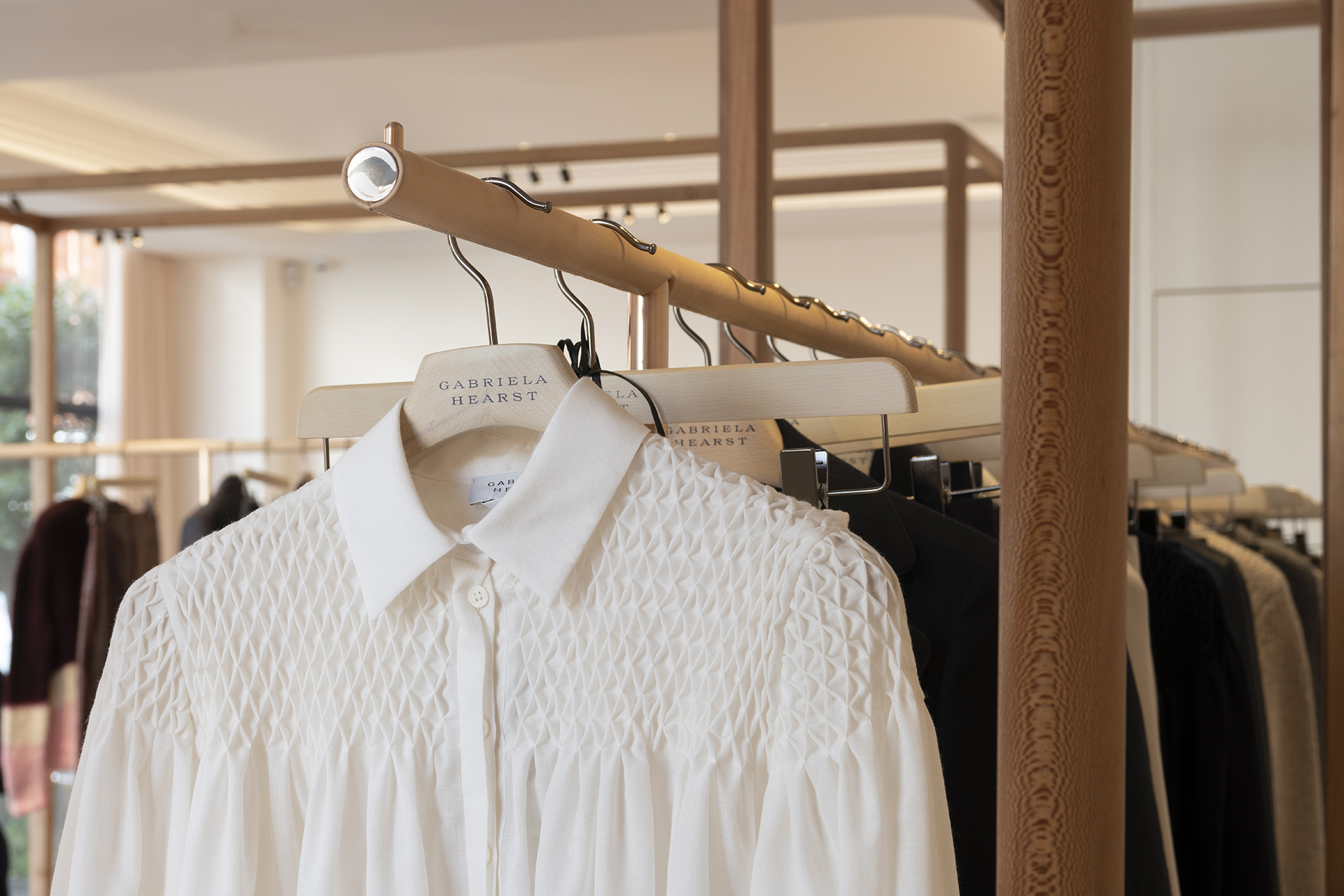 Clothes designed by Hearst, displayed on clothes rails by Foster + Partners | Gabriela Hearst London Store | Foster + Partners | STIRworld
