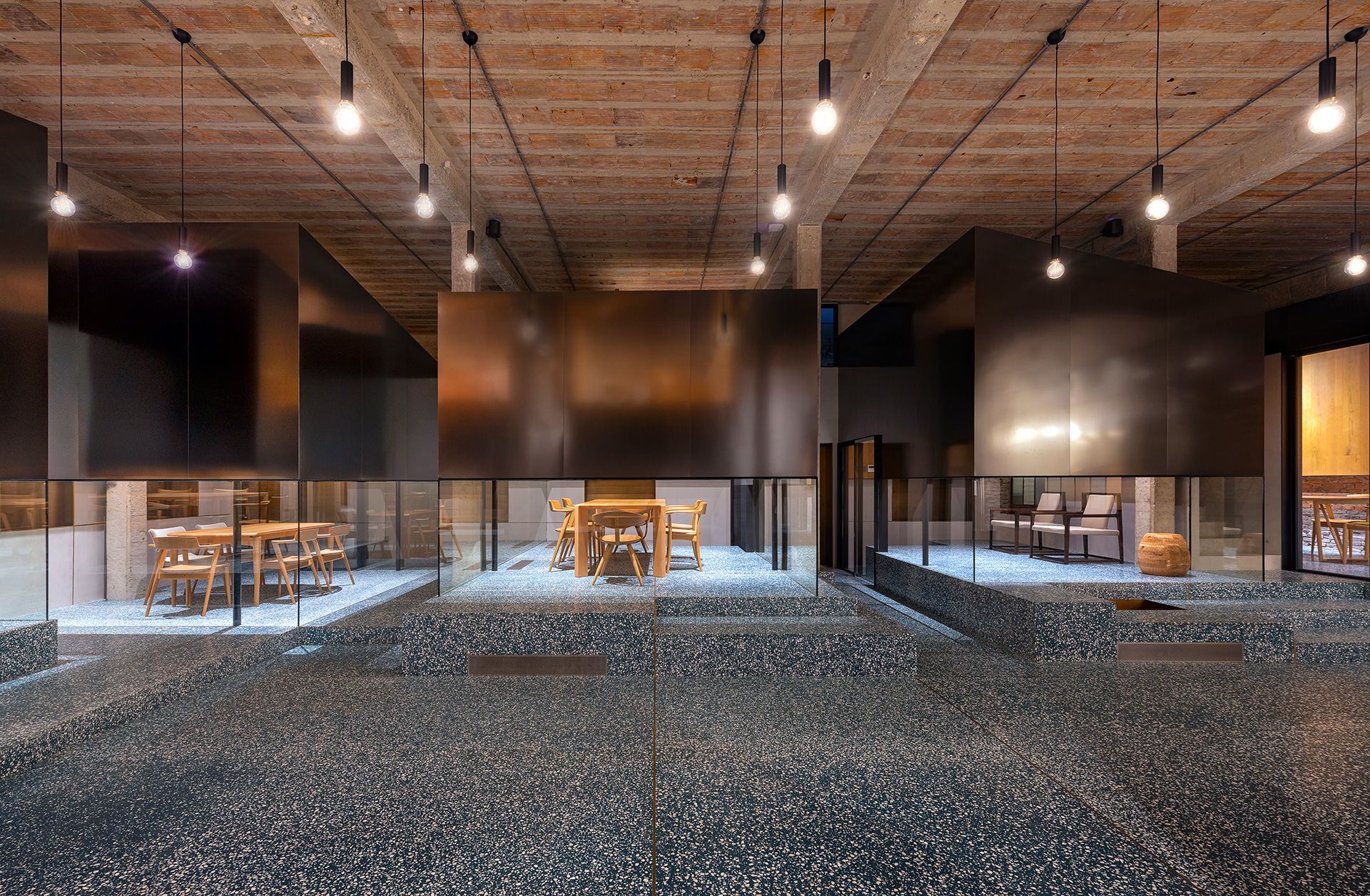 A view of the semi-open teahouses with brushed stainless steel and glass cladding | Tingtai Teahouse | Linehouse | STIRworld