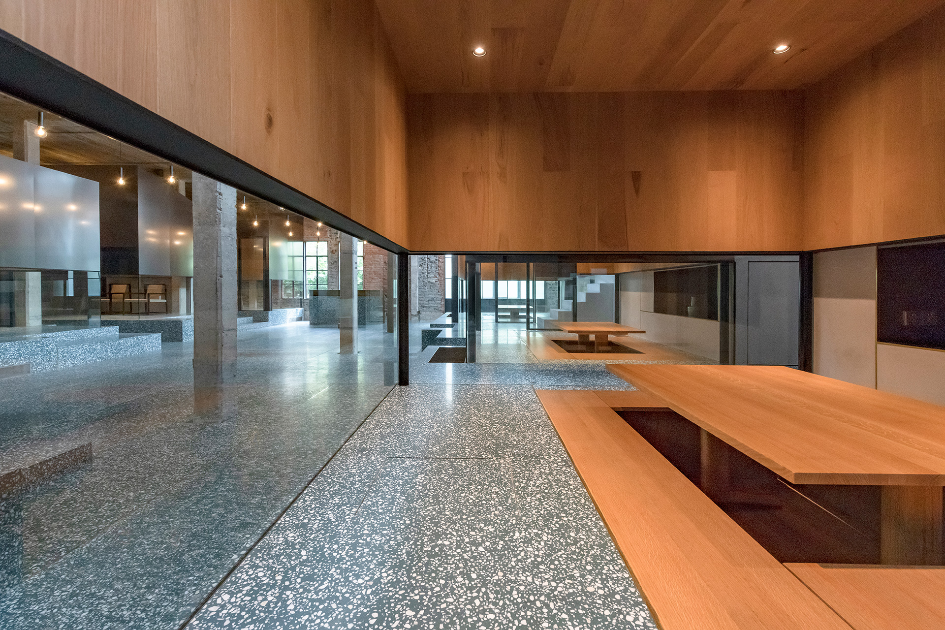 The lower level teahouse sits on a green terrazzo landscape with inbuilt oak seating | Tingtai Teahouse | Linehouse | STIRworld