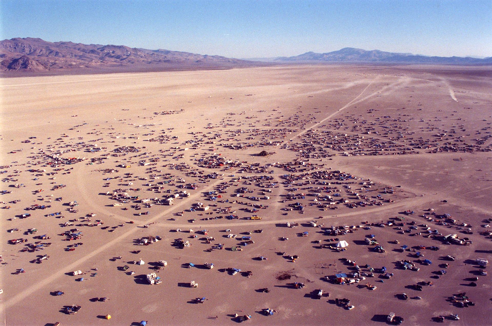 Aerial photograph of Black Rock City taken by an unknown photographer, 1996| No Spectators: The Art of Burning Man | Oakland Museum of California | STIRworld