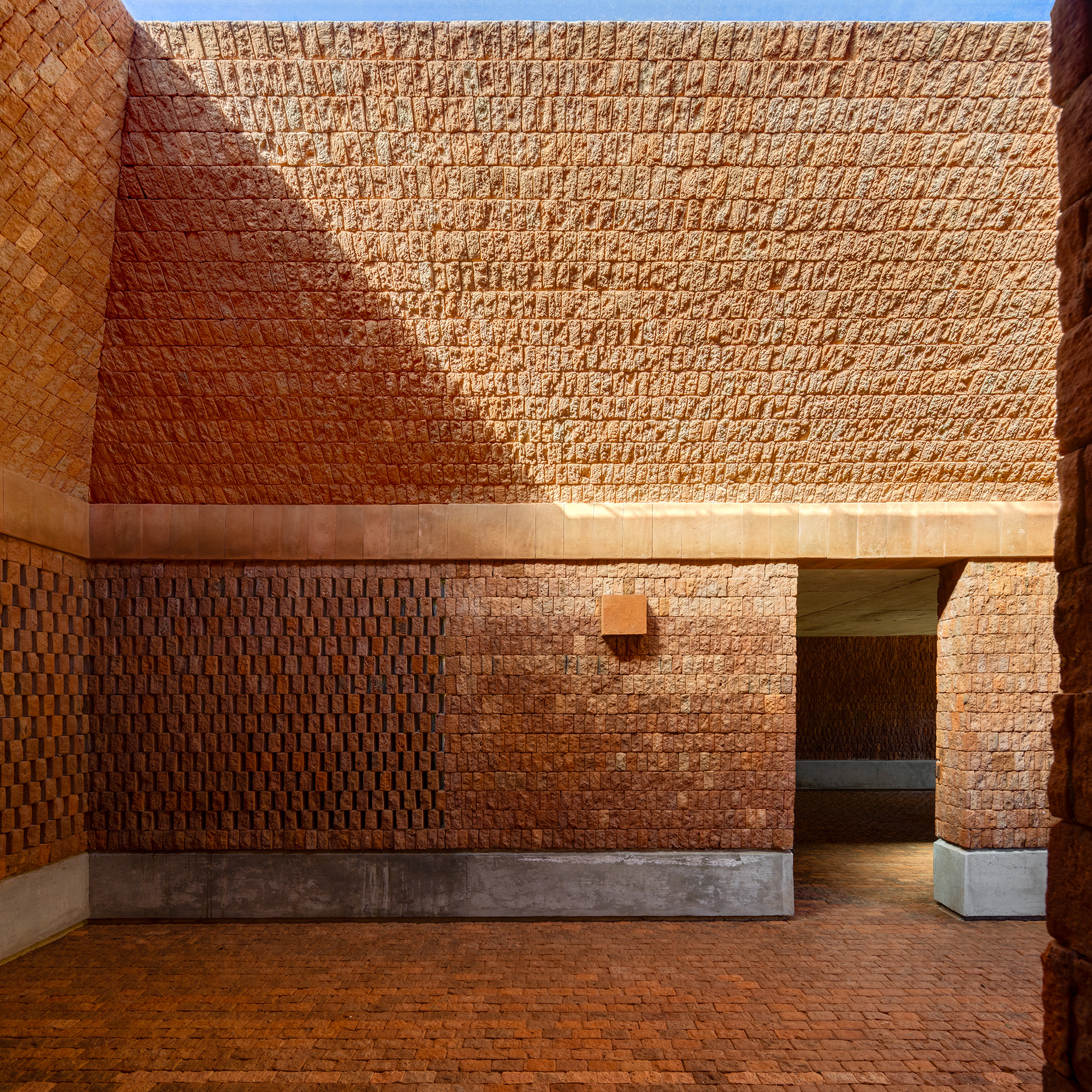 The courtyard defined by a brick wall | Fernanda Canales | Terreno House | Mexico | STIRworld