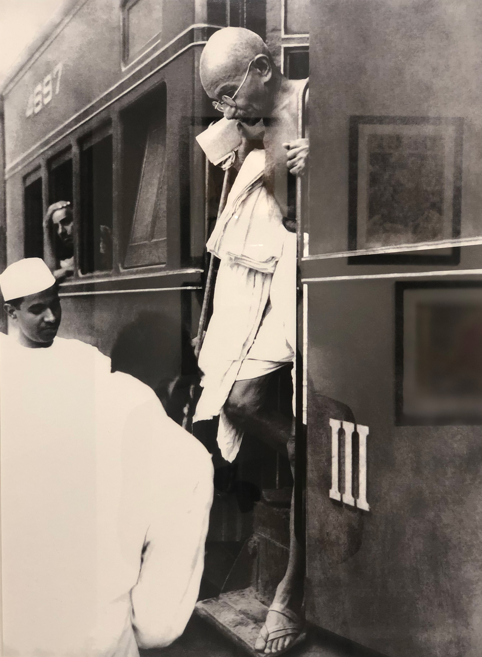 One of the photographs by Kulwant Roy, showing the Mahatma alighting from the train at New Delhi, in the 1940s | Exhibition | Santati | Mahatma Gandhi | STIRworld