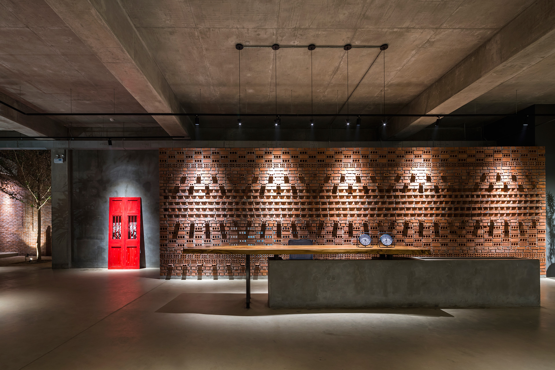 The reception desk with the brick backdrop | Studio VDGA | Deepak Guggari | STIRworld