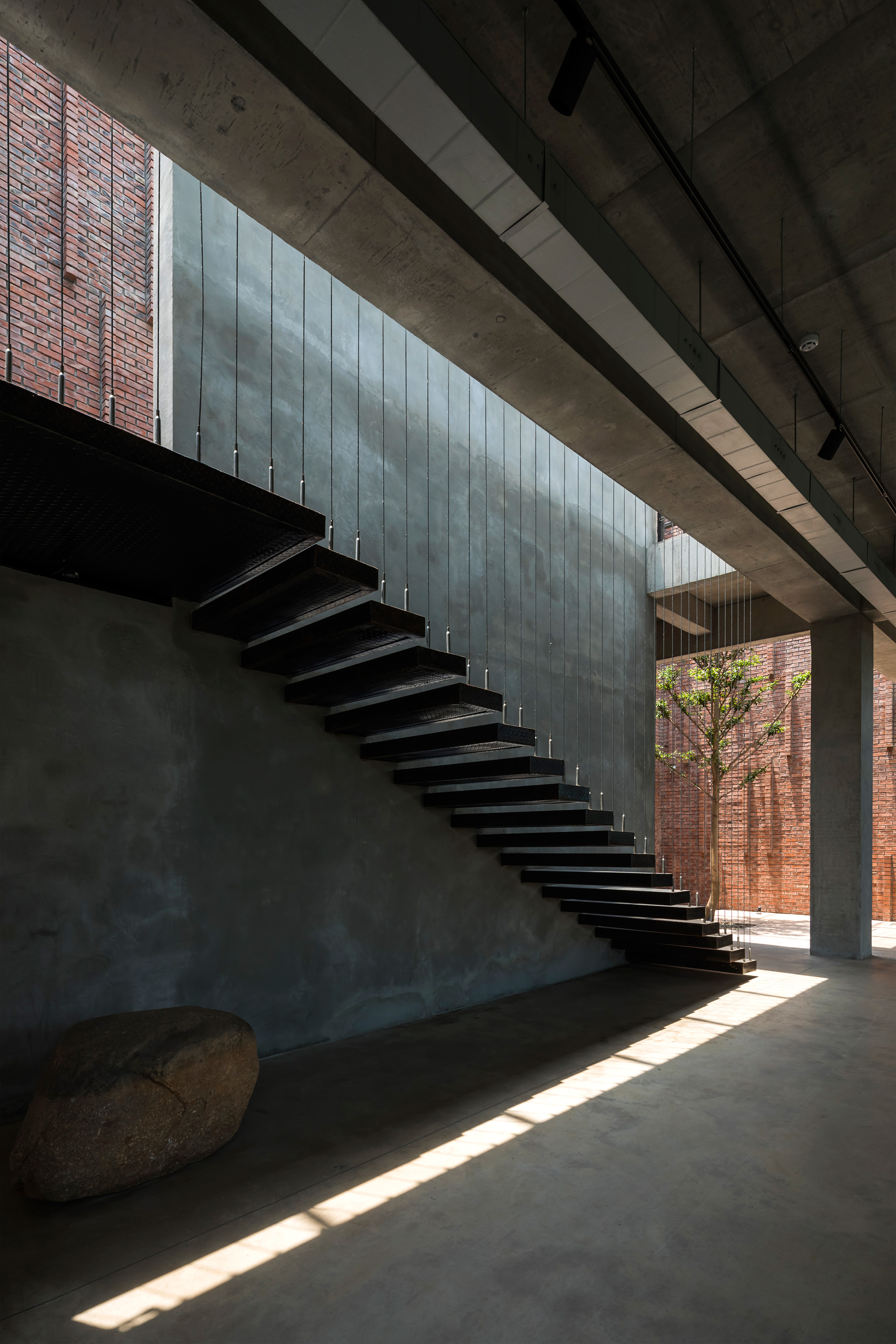 The floating staircase with its stretched metal rope railing | Studio VDGA | Deepak Guggari | STIRworld