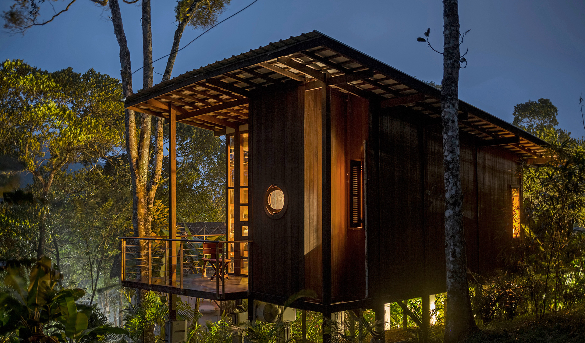 Night view of the cabin with the 'porthole' windows in the shower area | Cardomom Club| Kumar La Noche | Kerala | India | STIRworld
