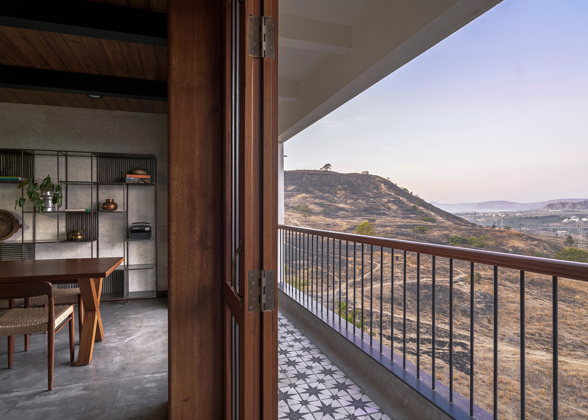Looking out over the hilly landscape from the living/dining area | Amoeba Design | STIRworld