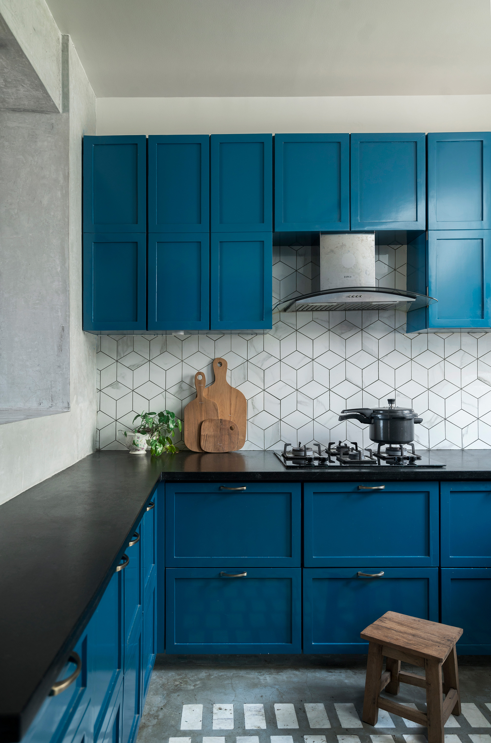 The blue cabinetry in the kitchen provides a cooling contrast to the earthy palette in the rest of the house | Amoeba Design | STIRworld
