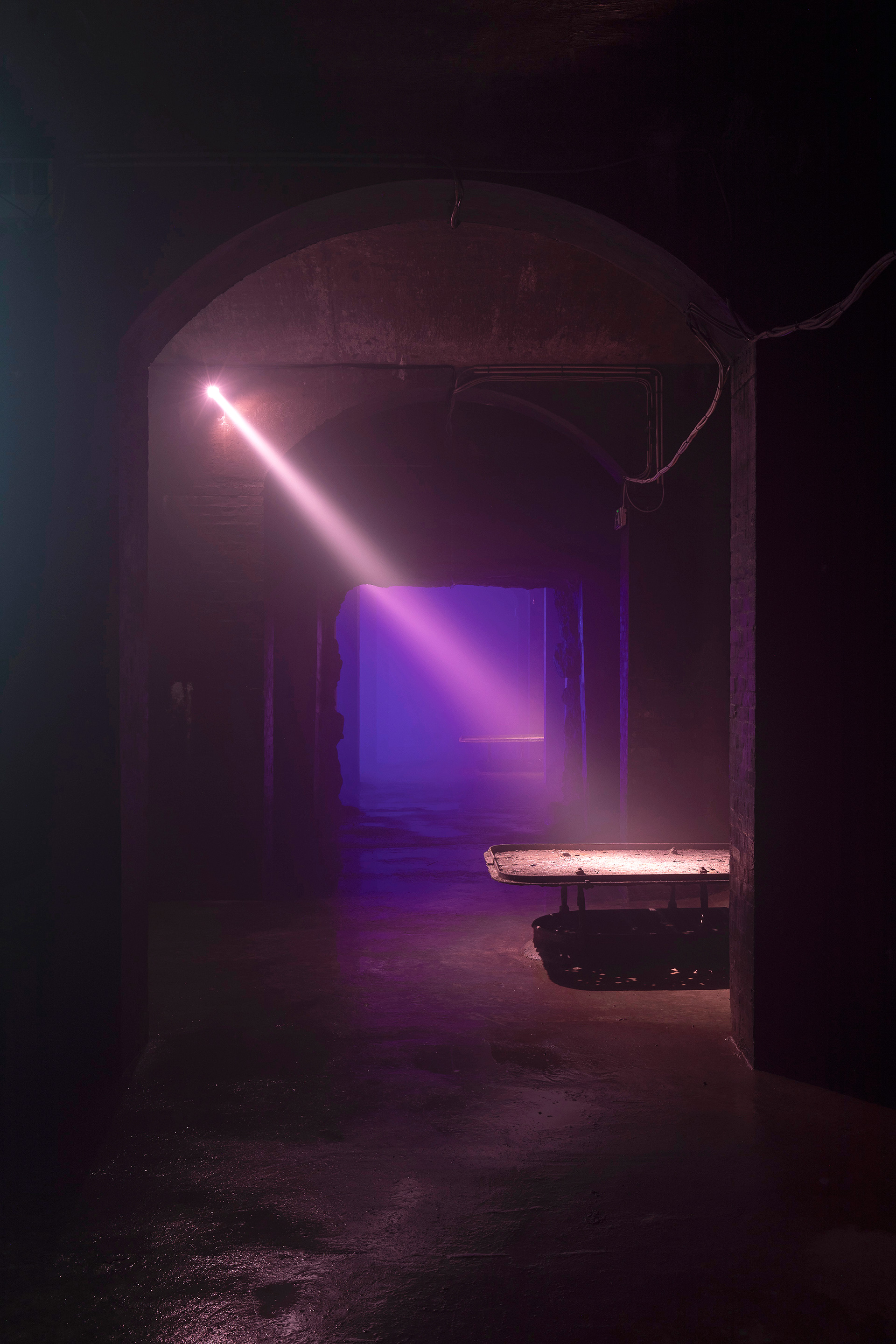 The use of light to reveal forgotten corners of the Cisternerne, as part of the Installation It is not the end of the world at Cisternerne, Copenhagen, Denmark |  SUPERFLEX | STIRworld
