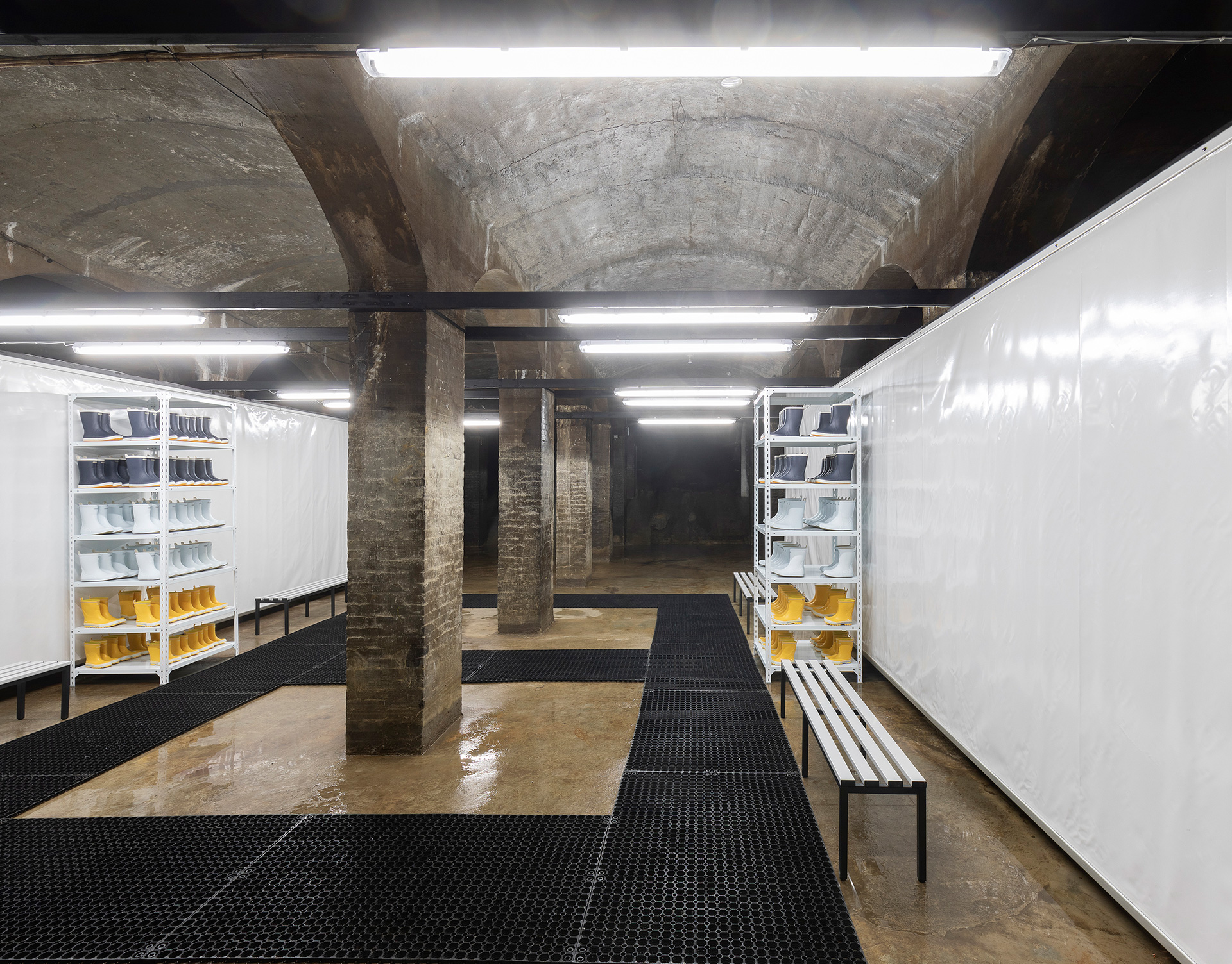The changing room where viewers are encouraged to wear protective rubber boots, as part of the Installation It is not the end of the world at Cisternerne, Copenhagen | SUPERFLEX | STIRworld