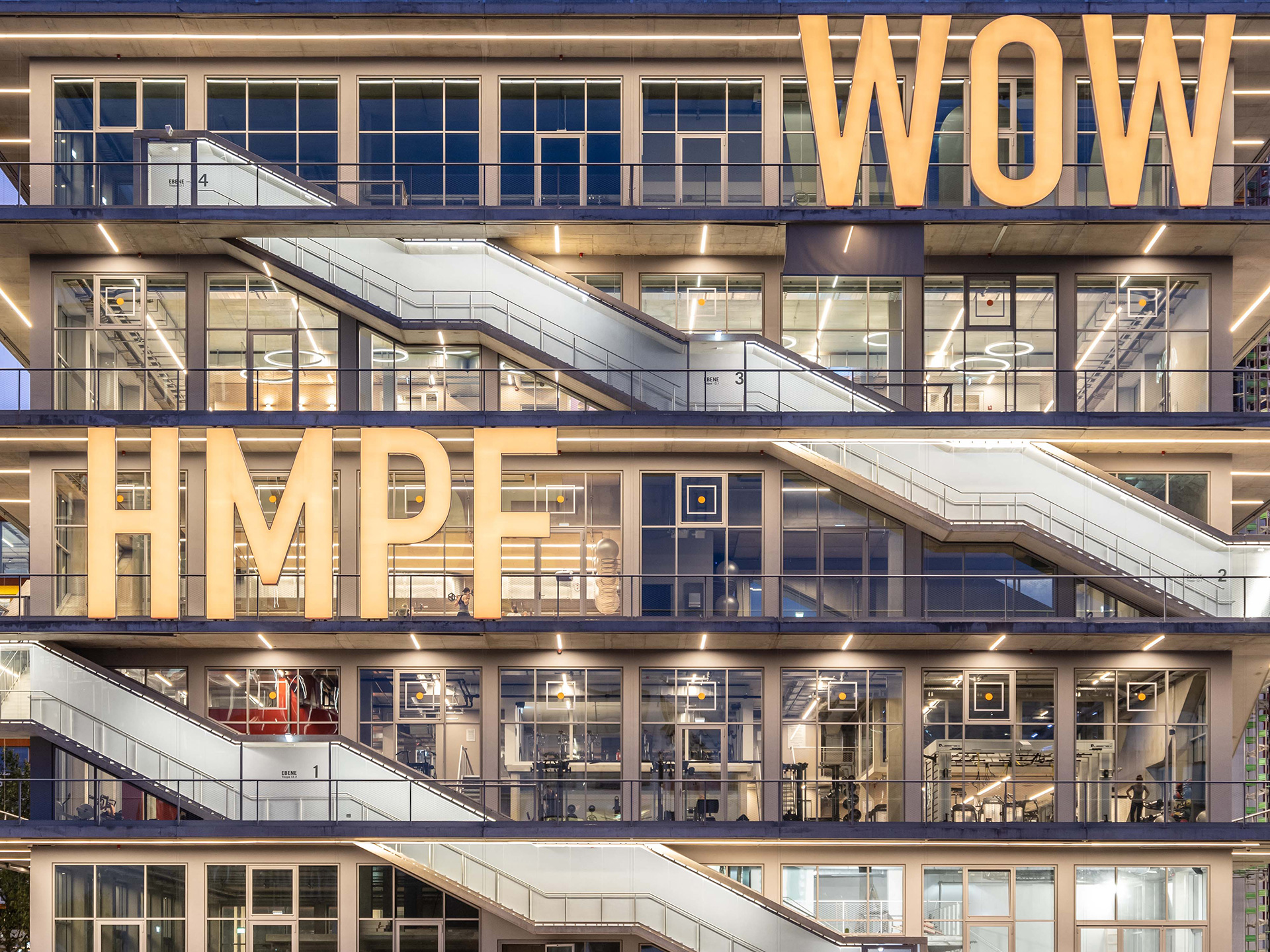 Comical expressions such as 'WOW' and 'HMPF' hosted on the structure's façade | WERK12 | MVRDV | STIRworld