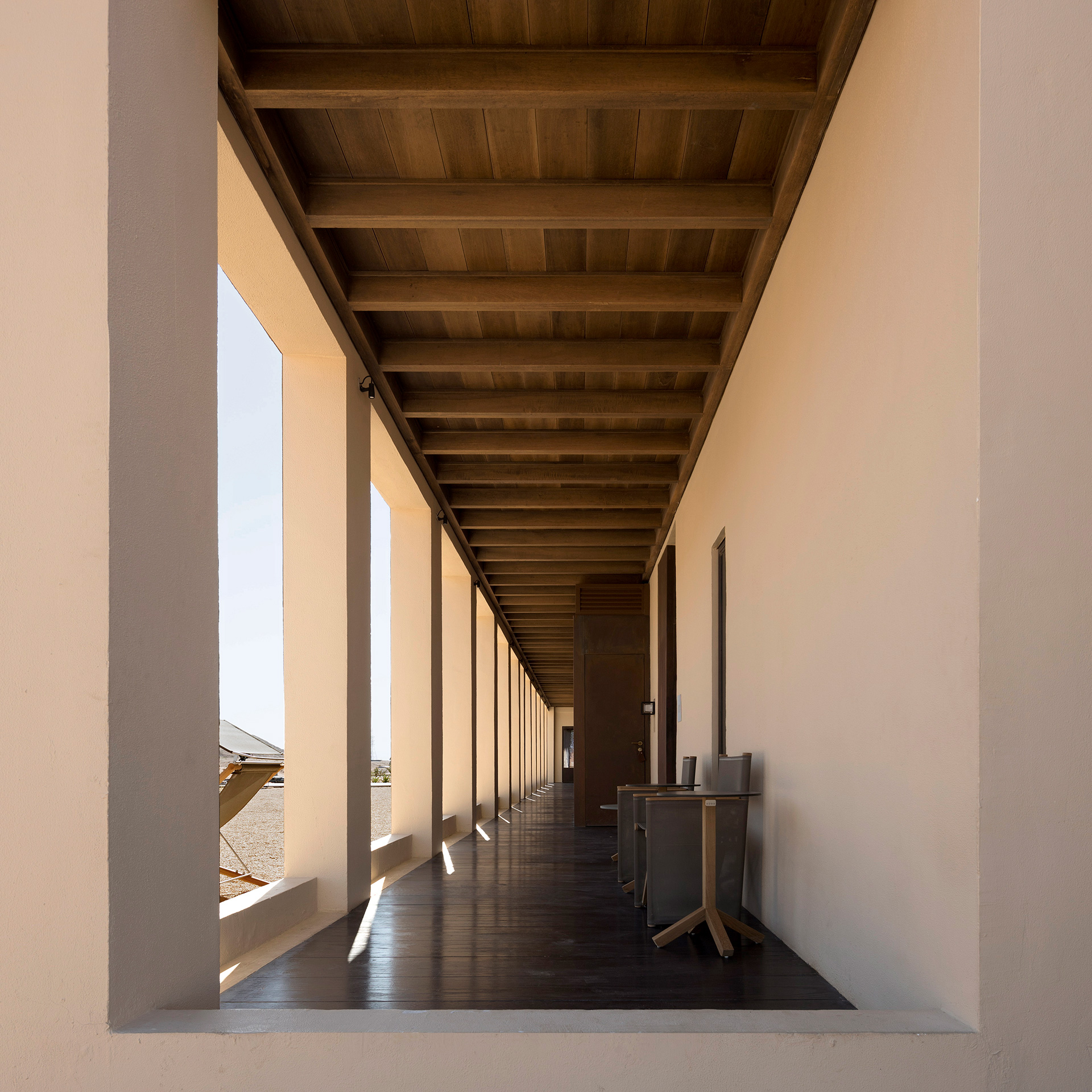 The passage running along the doorways of the bedrooms | Al Faya Lodge | Anarchitect | STIRworld