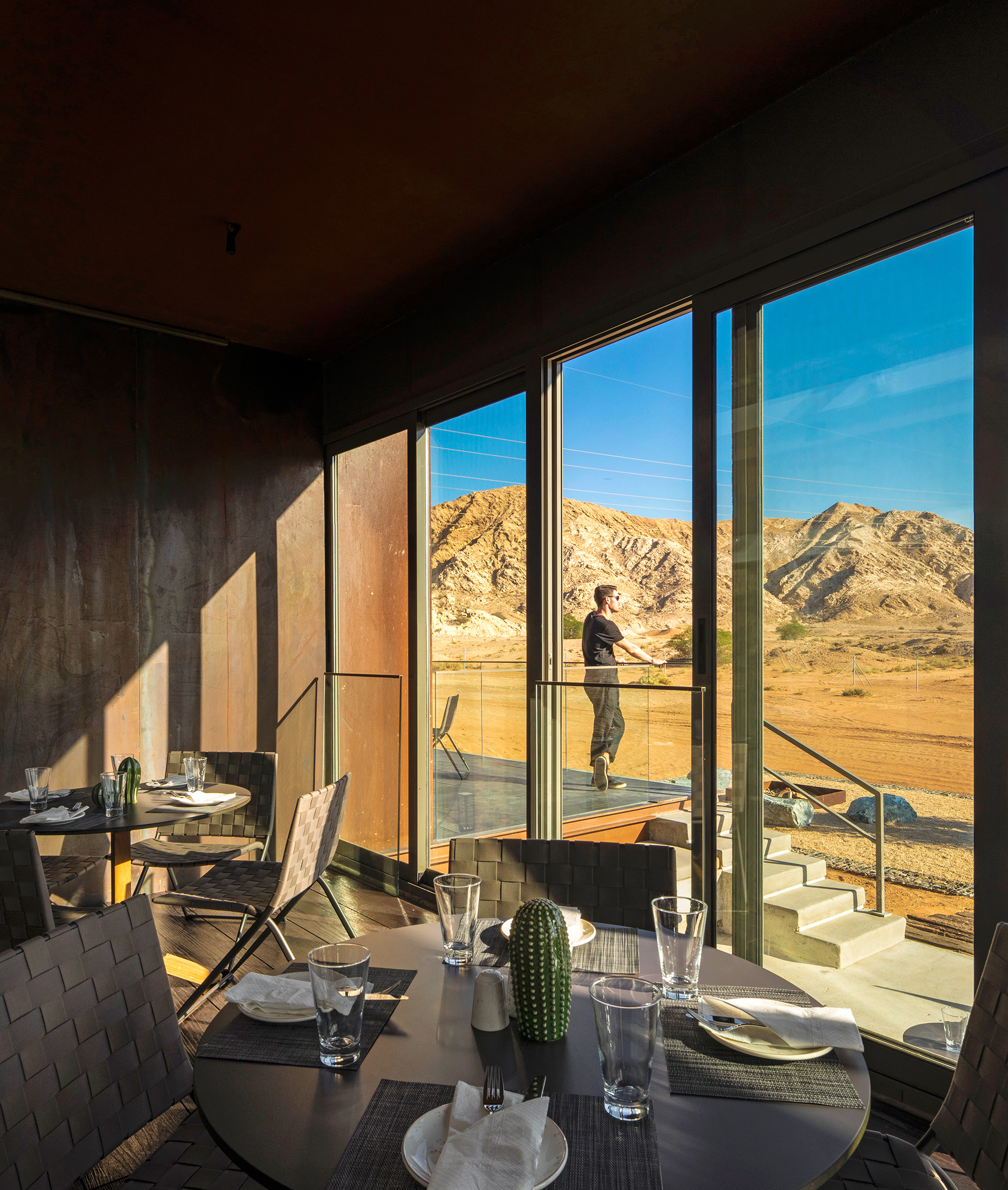 A portion of the dining room overlooking the desert landscape | Al Faya Lodge | Anarchitect | STIRworld
