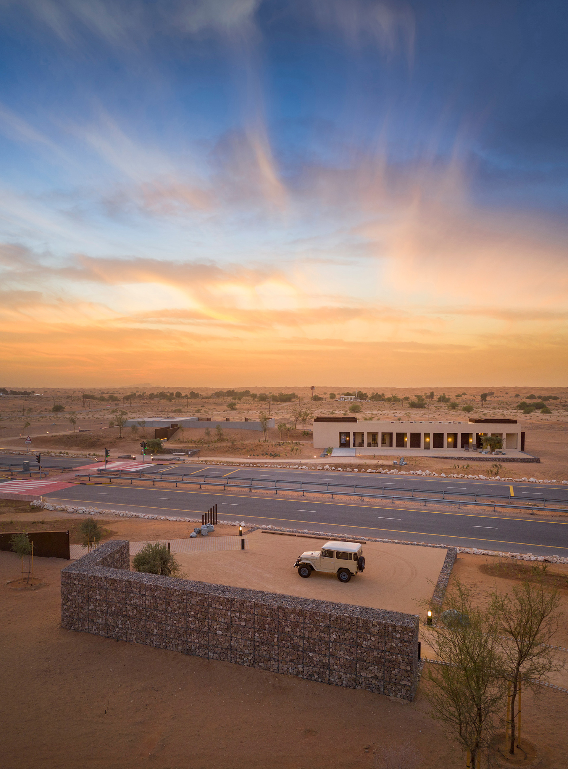 Aerial views of the three buildings of the Al Faya Lodge, with the tarmac road running through | Al Faya Lodge | Anarchitect | STIRworld