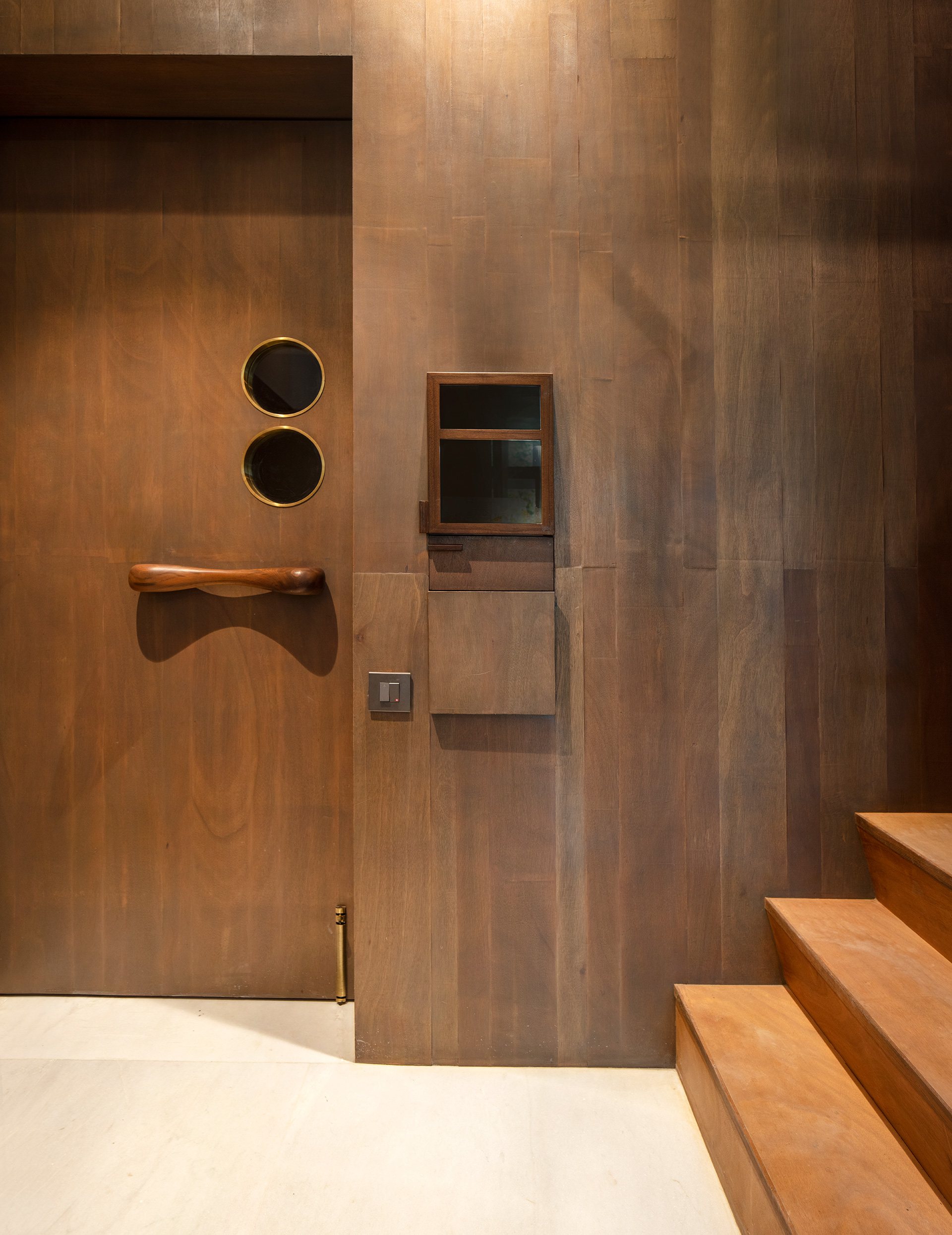 Entrance to the office, with the unique wooden door handle inspired from Isamu Noguchi's artwork | Samira Rathod Design Atelier | Mumbai | STIRworld