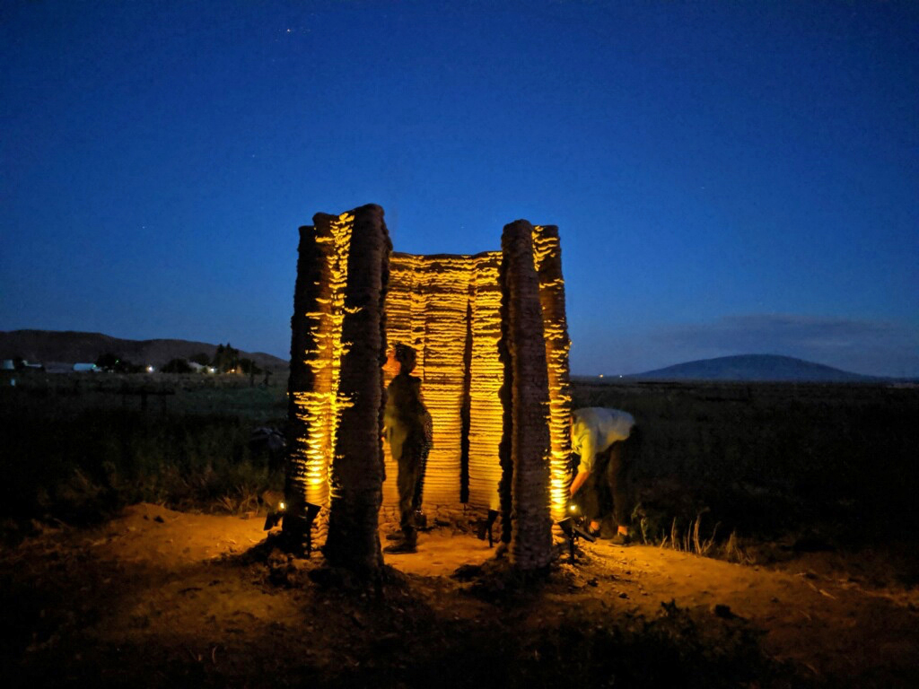 An illuminated 'Beacon' prototype at night | Mud Frontiers | Emerging Objects | STIRworld