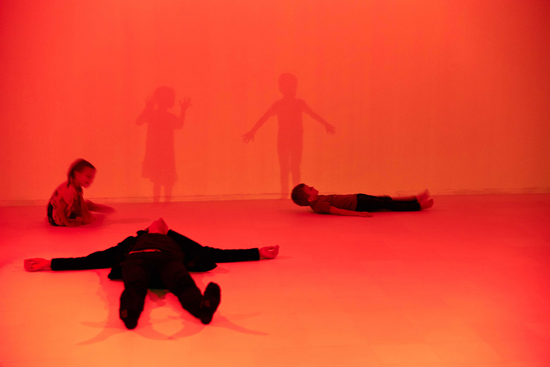Visitors lie down in the vacant white cube| Presence | Daan Roosegaarde | Groninger Museum| STIRworld
