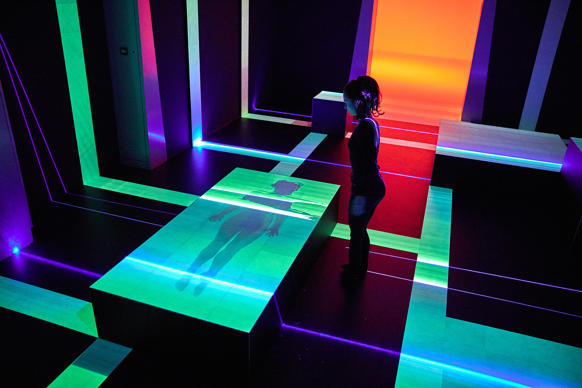 As the light is blocked by visitors, it leaves traces and prints on the light sensitive floor | Presence | Daan Roosegaarde | Groninger Museum| STIRworld