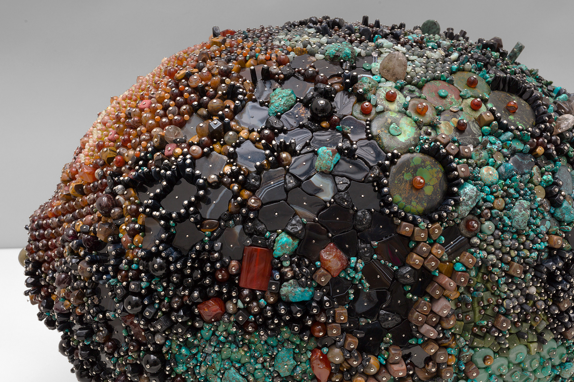 Kathleen Ryan, Black Lemon, Obsidian, black onyx, agate, turquoise, pyrite, tiger eye, jasper, smokey quartz, tektite, lapis lazuli, aventurine, and other precious stones coated with polystyrene, 19 x 18 x 27 inches, 2019 | Kathleen Ryan | STIRworld