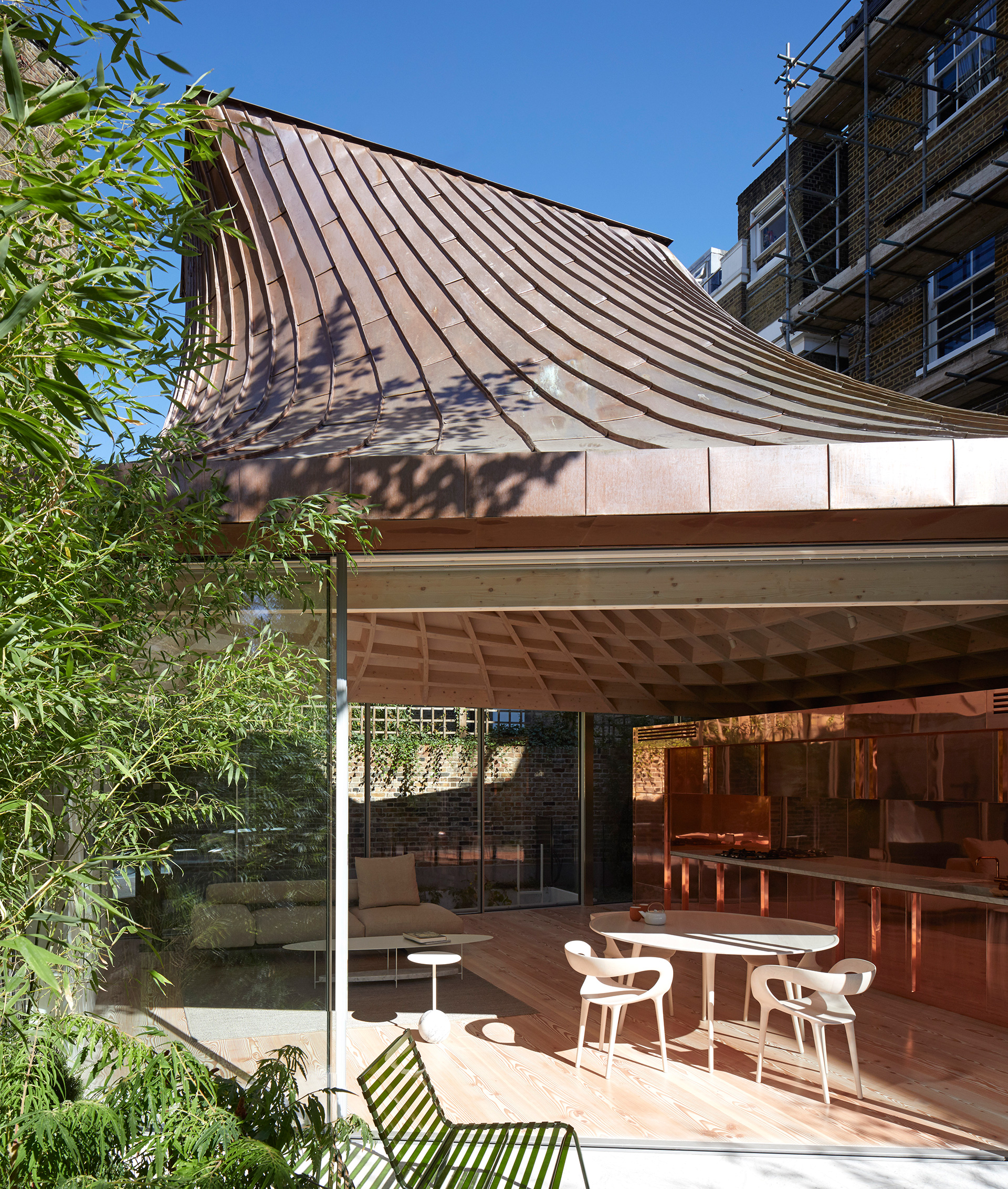 The entire house enmeshed with complex yet beautiful details comes together as a holistic entity | House in a Garden, London by Gianni Botsford Architects | STIRworld