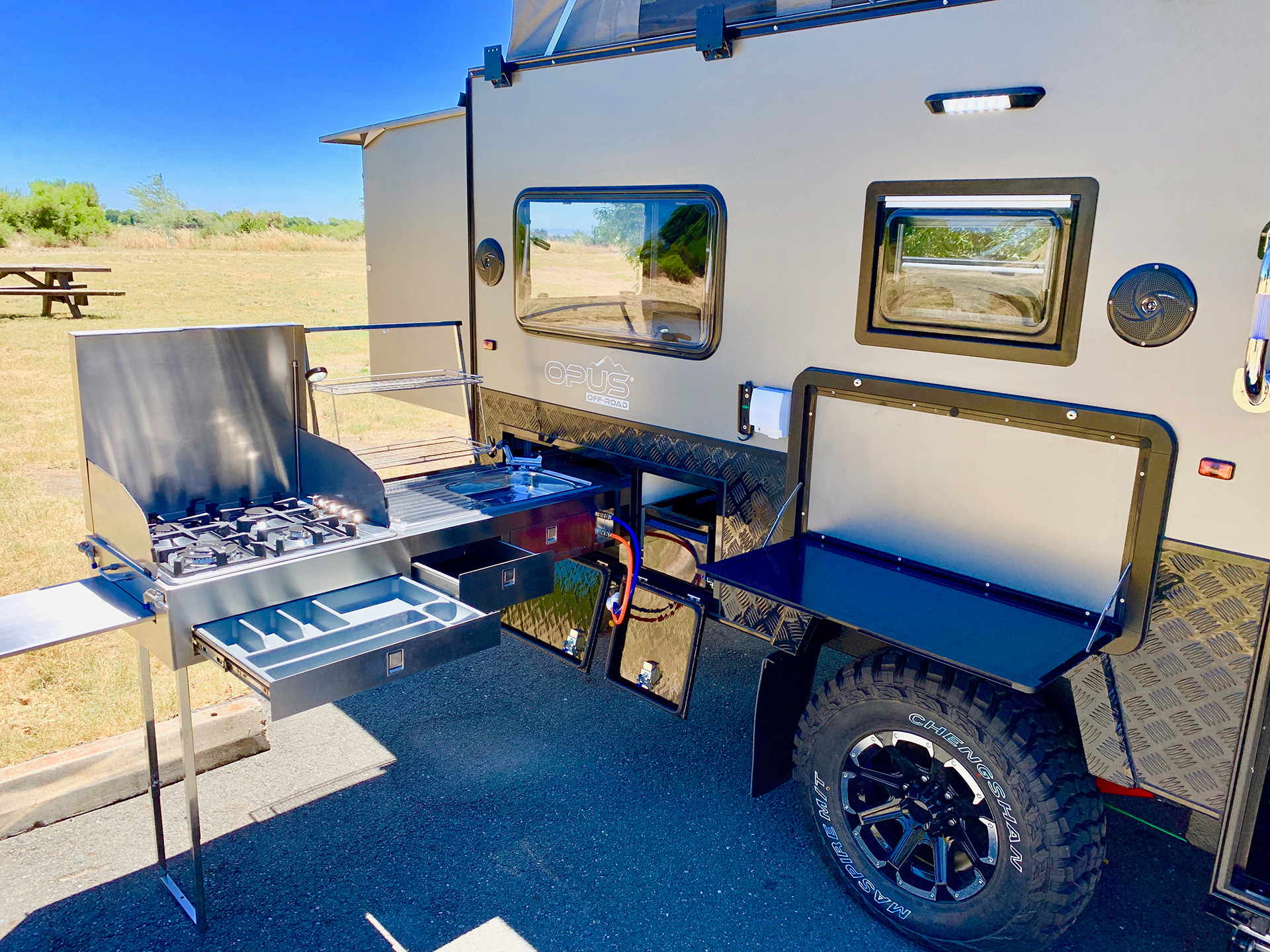 A fully functional kitchen outside the trailer | OP 15 | OPUS Camper| STIRworld