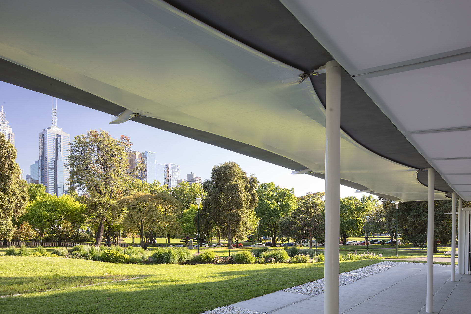 The roof provides shade in summer, while providing a view of the gardens to the river and the city | MPavilion 2019| Australia | Glenn Murcutt| STIRworld