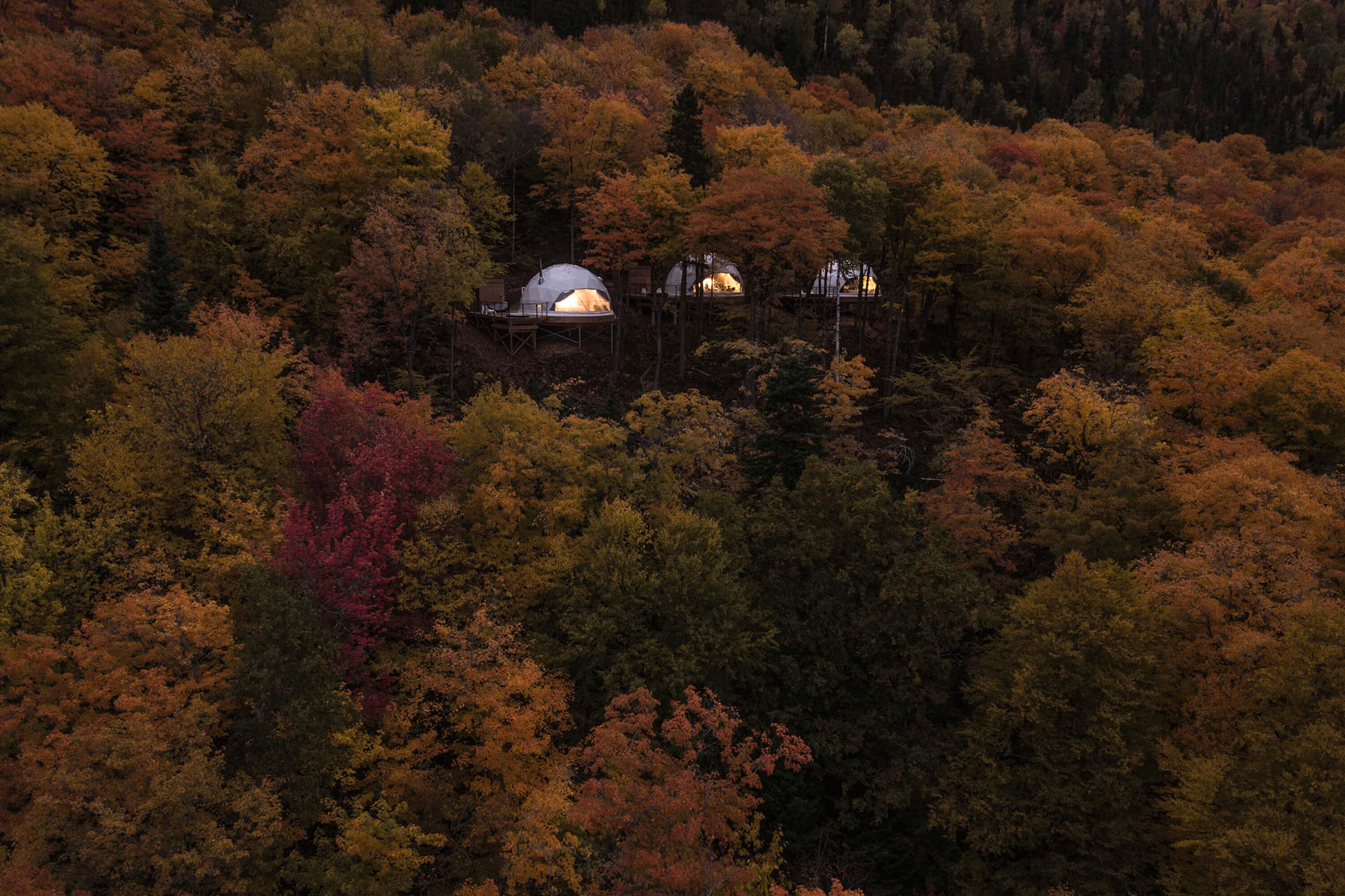 The domes of Charlevoix shining in the night like candles in the wind |Glamping| Resorts | STIRworld